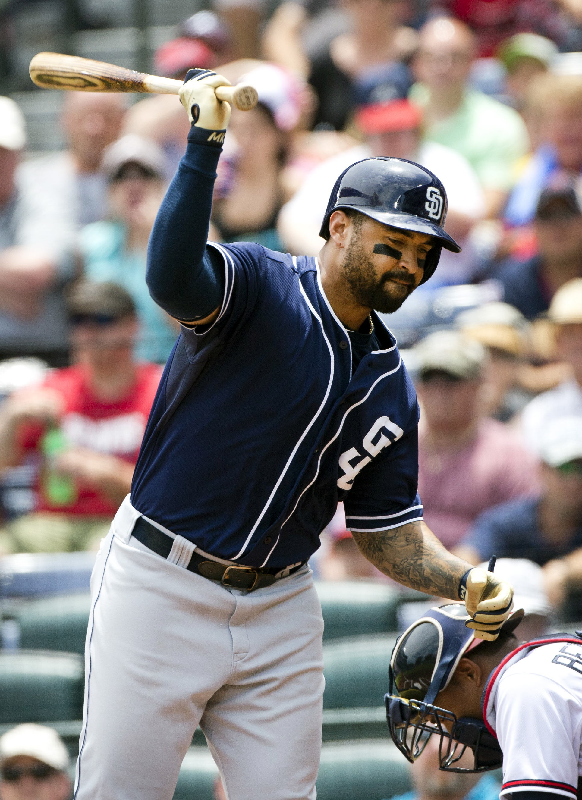 San Diego Padres' Matt Kemp reacts after he was hit by a pitch from Atlanta Braves starter Juio Teheran in the first inning of a baseball game Thursday, June 11, 2015, in Atlanta. The incident led to both dugouts emptying onto the field. (AP Photo/John Ba
