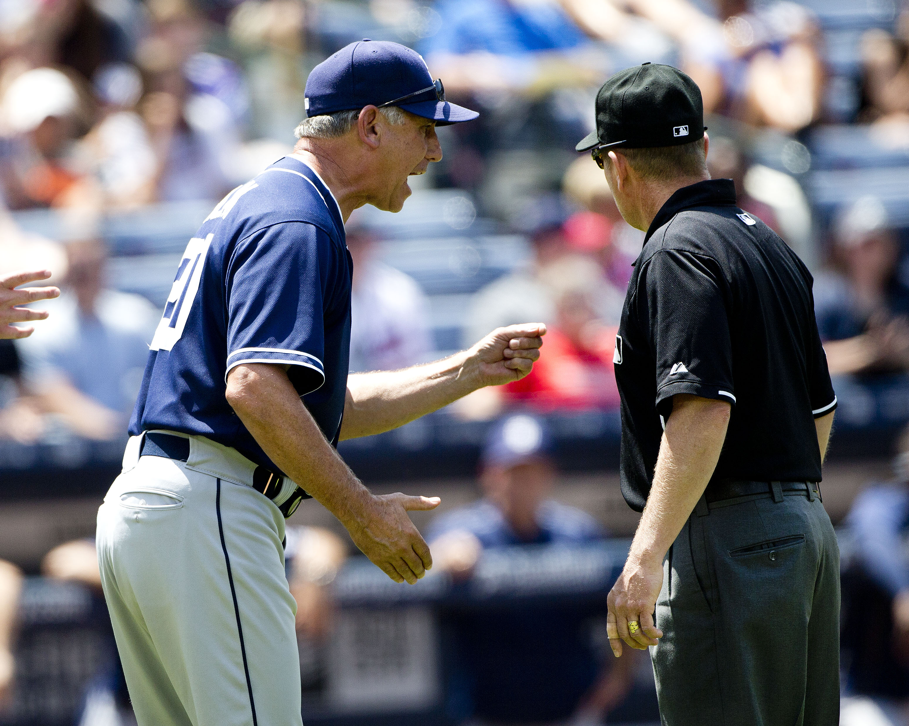 San Diego Padres manager Bud Black, left, argues a call with an umpire before being ejected in the seventh inning of a baseball game against the Atlanta Braves, Thursday, June 11, 2015, in Atlanta. San Diego won 6-4 in 11 innings. (AP Photo/John Bazemore)