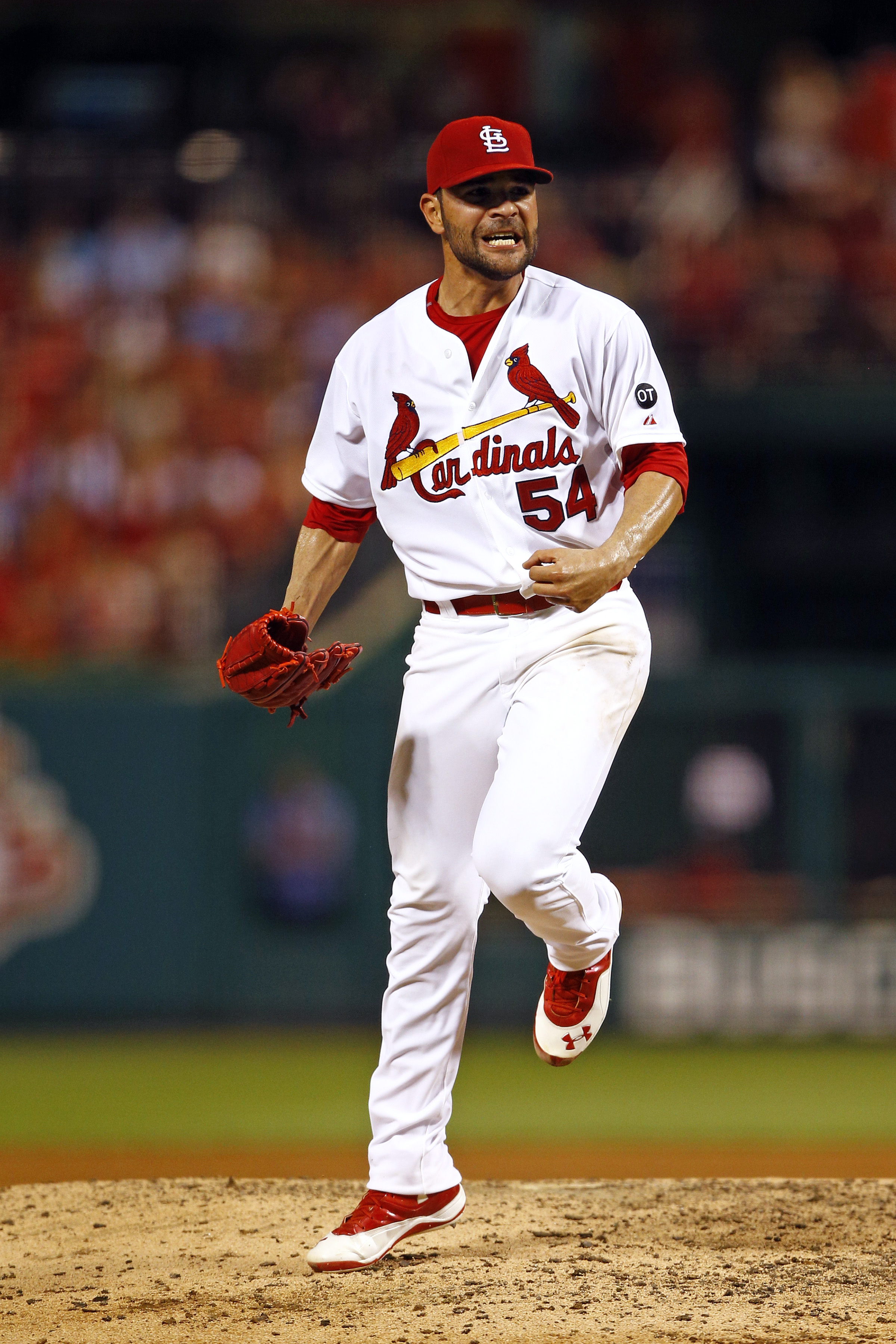 St. Louis Cardinals starting pitcher Jaime Garcia reacts after striking out Kansas City Royals' Eric Hosmer during the sixth inning of a baseball game Friday, June 12, 2015, in St. Louis. (AP Photo/Billy Hurst)