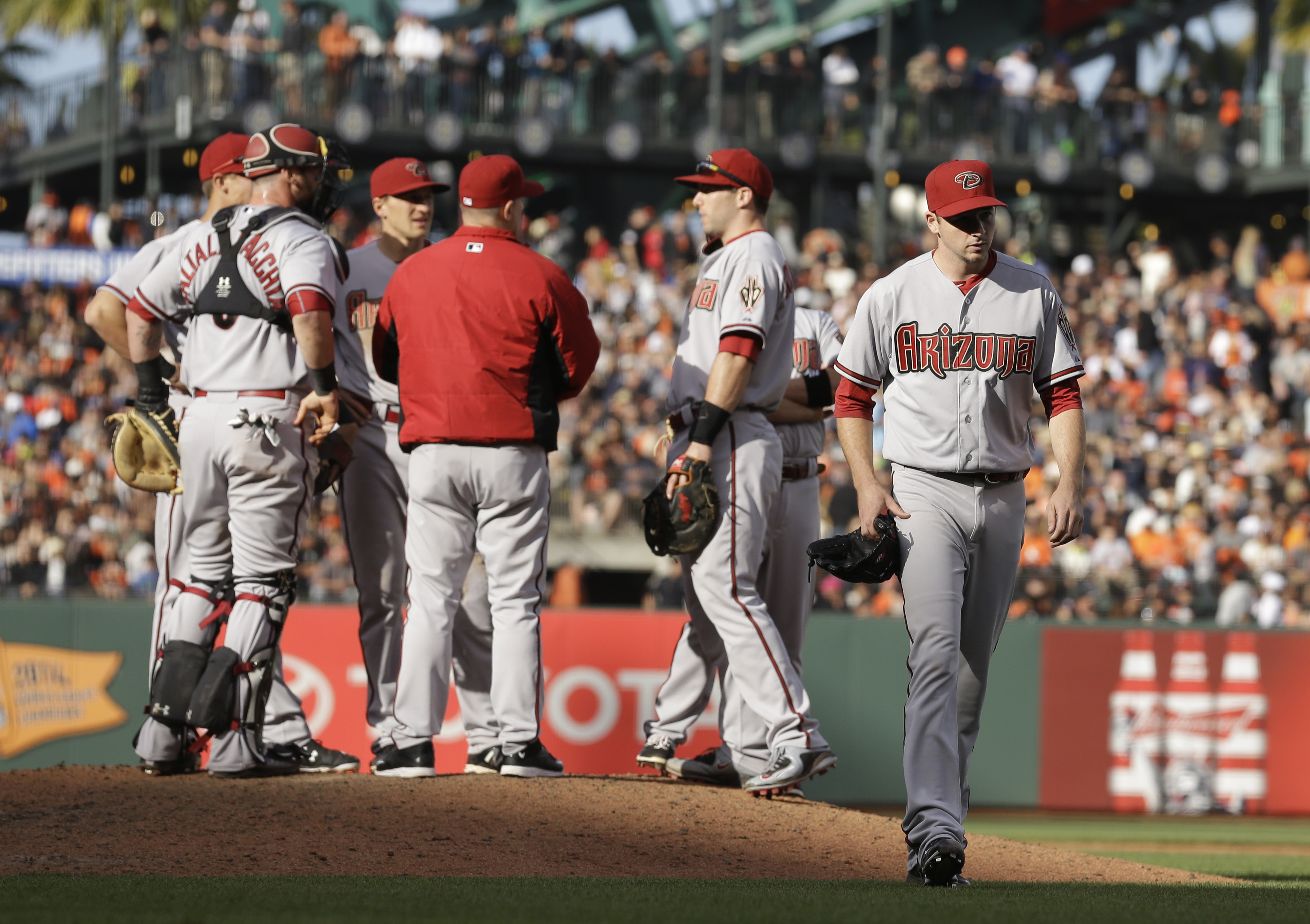 Arizona Diamondbacks' Allen Webster, right, leaves the baseball game against the San Francisco Giants in the sixth inning Saturday, June 13, 2015, in San Francisco. (AP Photo/Ben Margot)