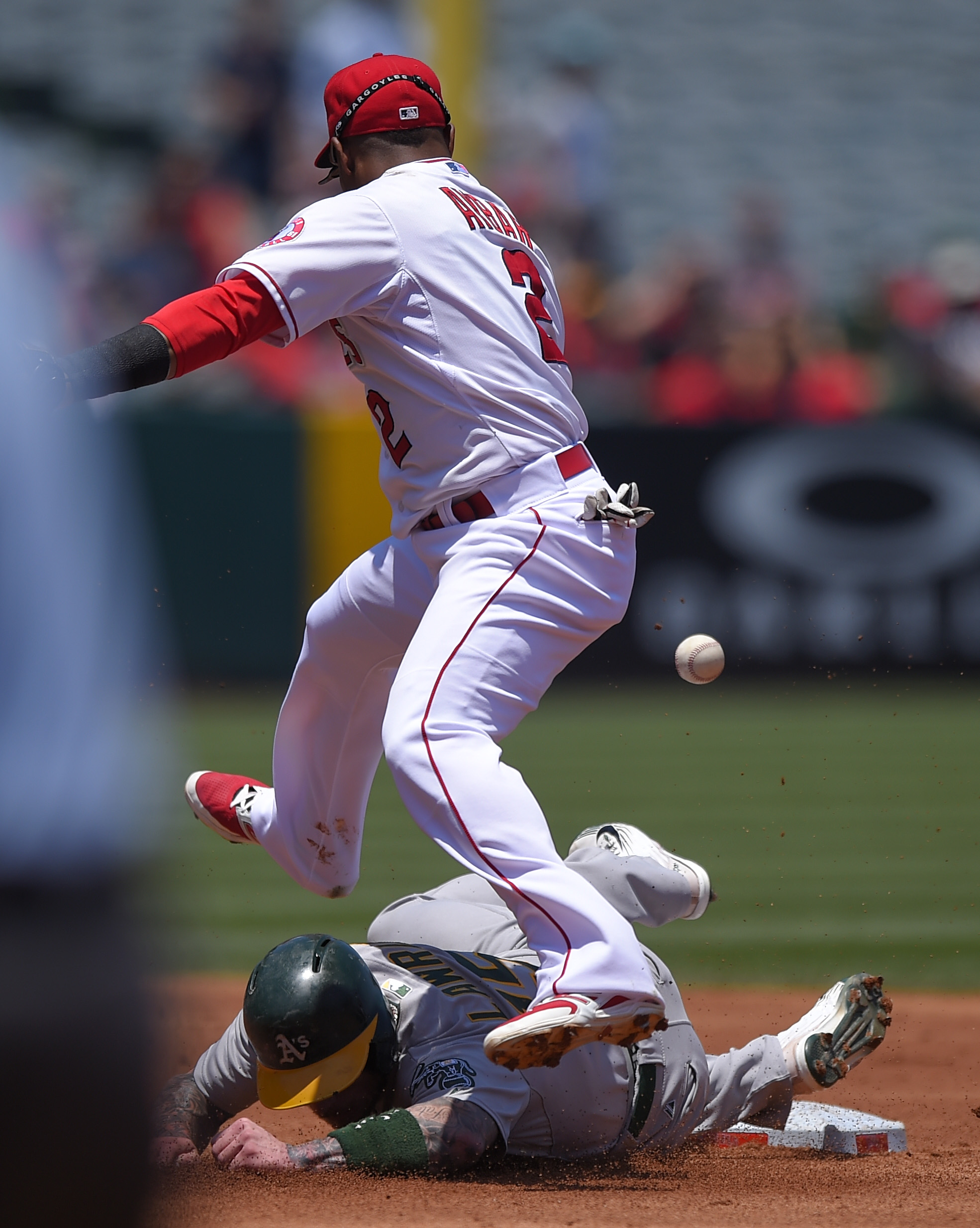 Oakland Athletics' Brett Lawrie, below, is forced out at second as Los Angeles Angels shortstop Erick Aybar looses the ball and is unable to throw out Max Muncy at first during the second inning of a baseball game, Sunday, June 14, 2015, in Anaheim, Calif