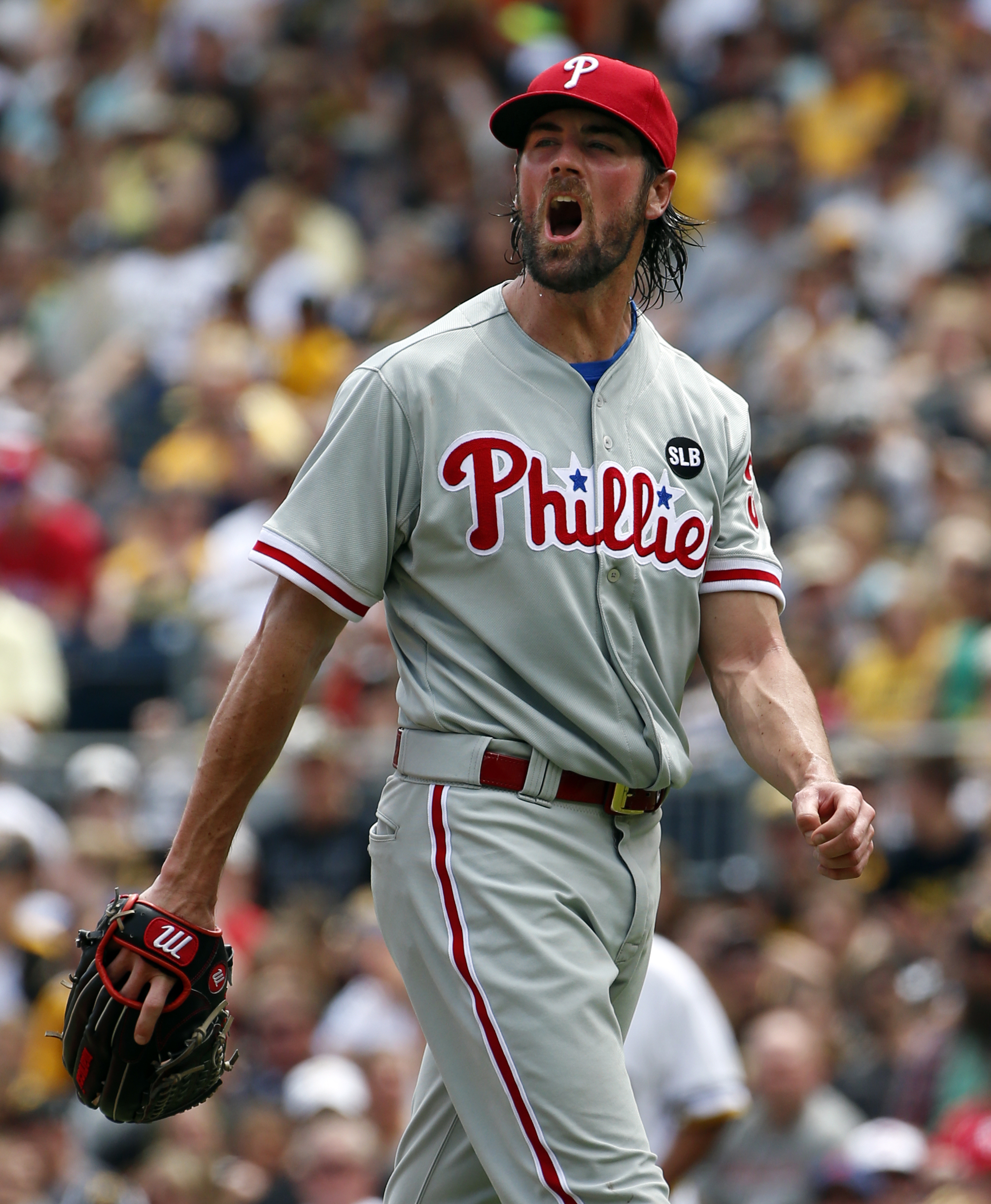 Philadelphia Phillies starting pitcher Cole Hamels walks to the dugout after pitching the fourth inning of a baseball game against the Pittsburgh Pirates in Pittsburgh, Sunday, June 14, 2015. The Pirates won 1-0 in 11 innings. (AP Photo/Gene J. Puskar)