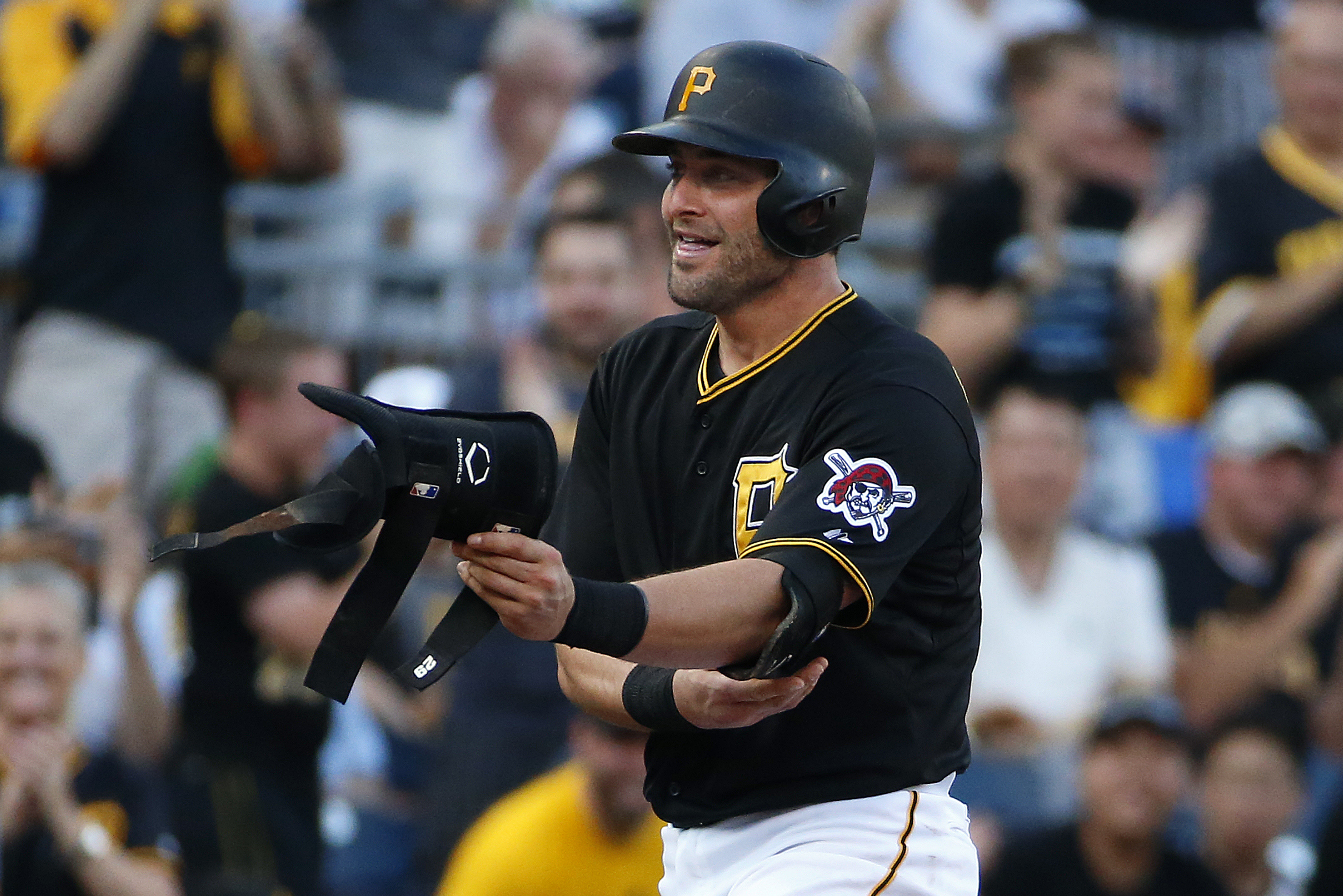 Pittsburgh Pirates' Francisco Cervelli stands on third base after driving in two runs with a triple off Chicago White Sox starting pitcher Carlos Rodon during the first inning of a baseball game in Pittsburgh, Monday, June 15, 2015. (AP Photo/Gene J. Pusk
