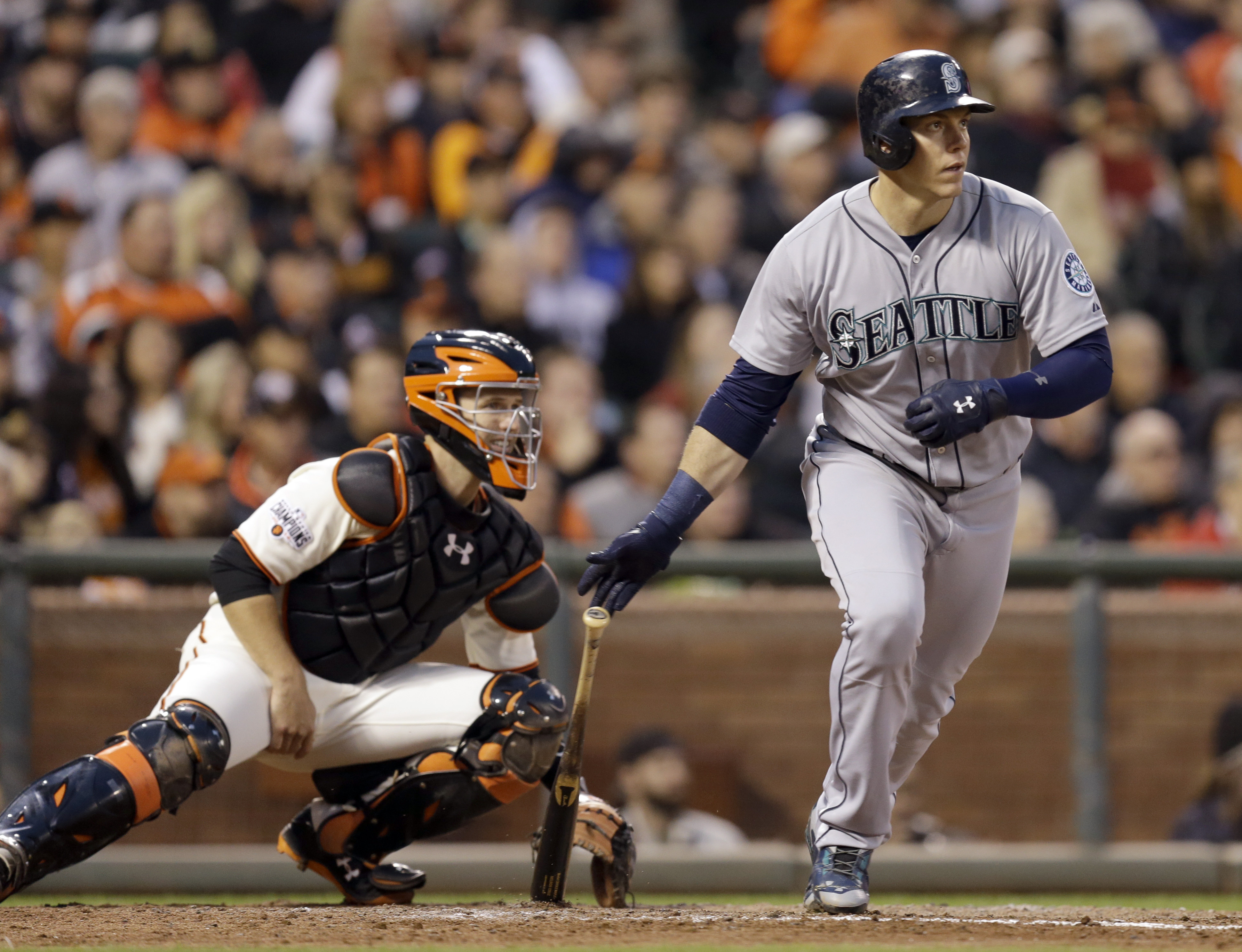 Seattle Mariners' Logan Morrison drops his bat after hitting an RBI single off San Francisco Giants' Tim Hudson during the fifth inning of a baseball game Monday, June 15, 2015, in San Francisco. (AP Photo/Ben Margot)