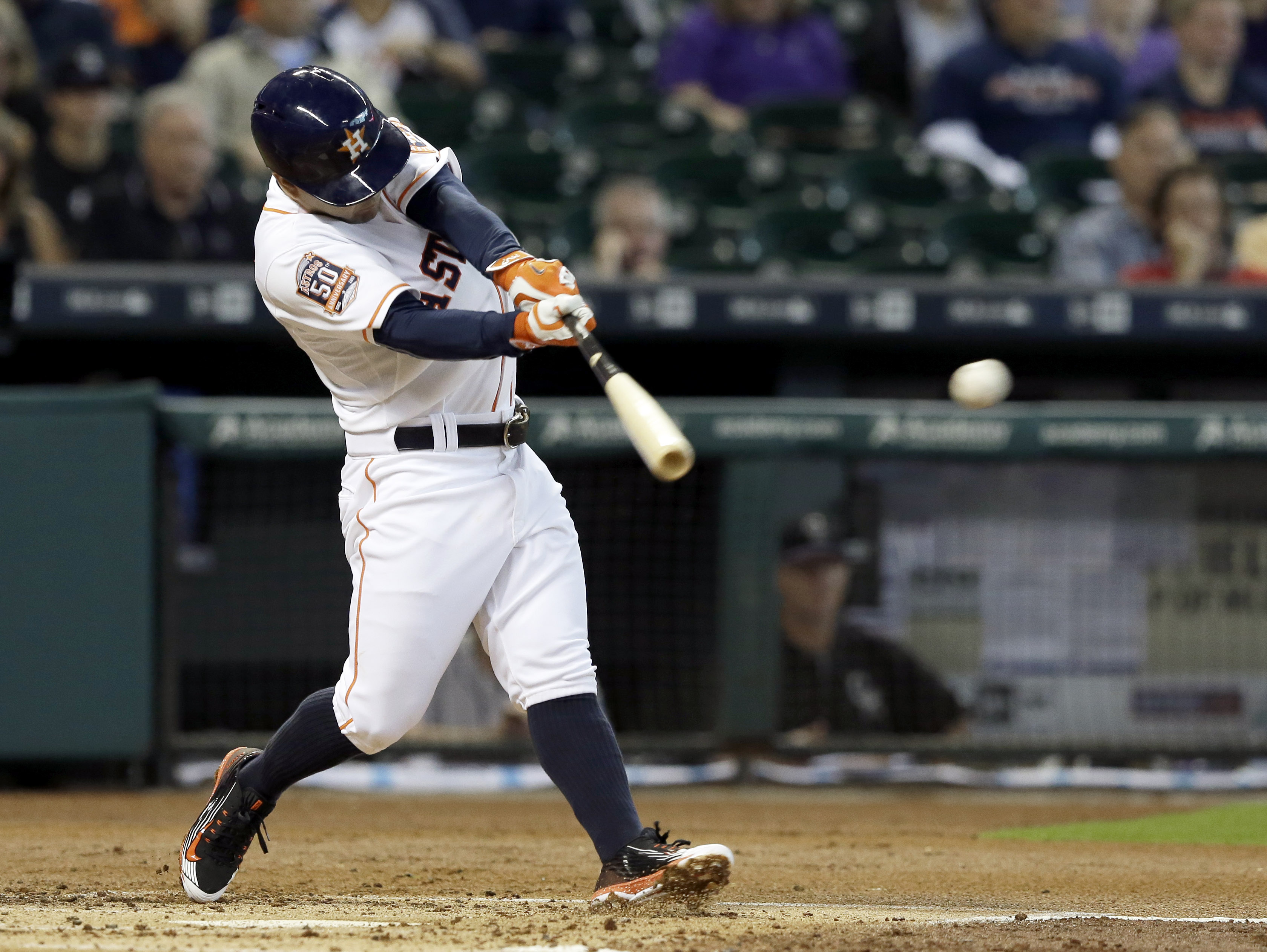 Houston Astros' Jose Altuve hits an RBI single against the Colorado Rockies in the first inning of a baseball game Tuesday, June 16, 2015, in Houston. (AP Photo/Pat Sullivan)