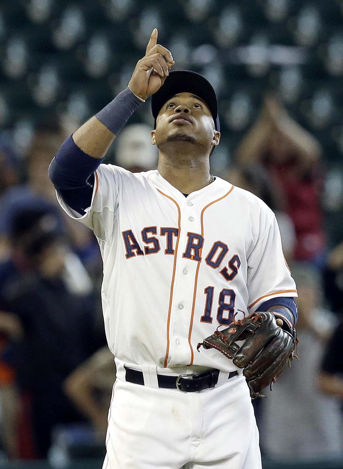 Houston Astros' Luis Valbuena points up as he heads off the field after the Astros beat the Colorado Rockies 8-5 in a baseball game Tuesday, June 16, 2015, in Houston. Valbuena hit two home runs in the game for four of the Astros eight runs. (AP Photo/Pat