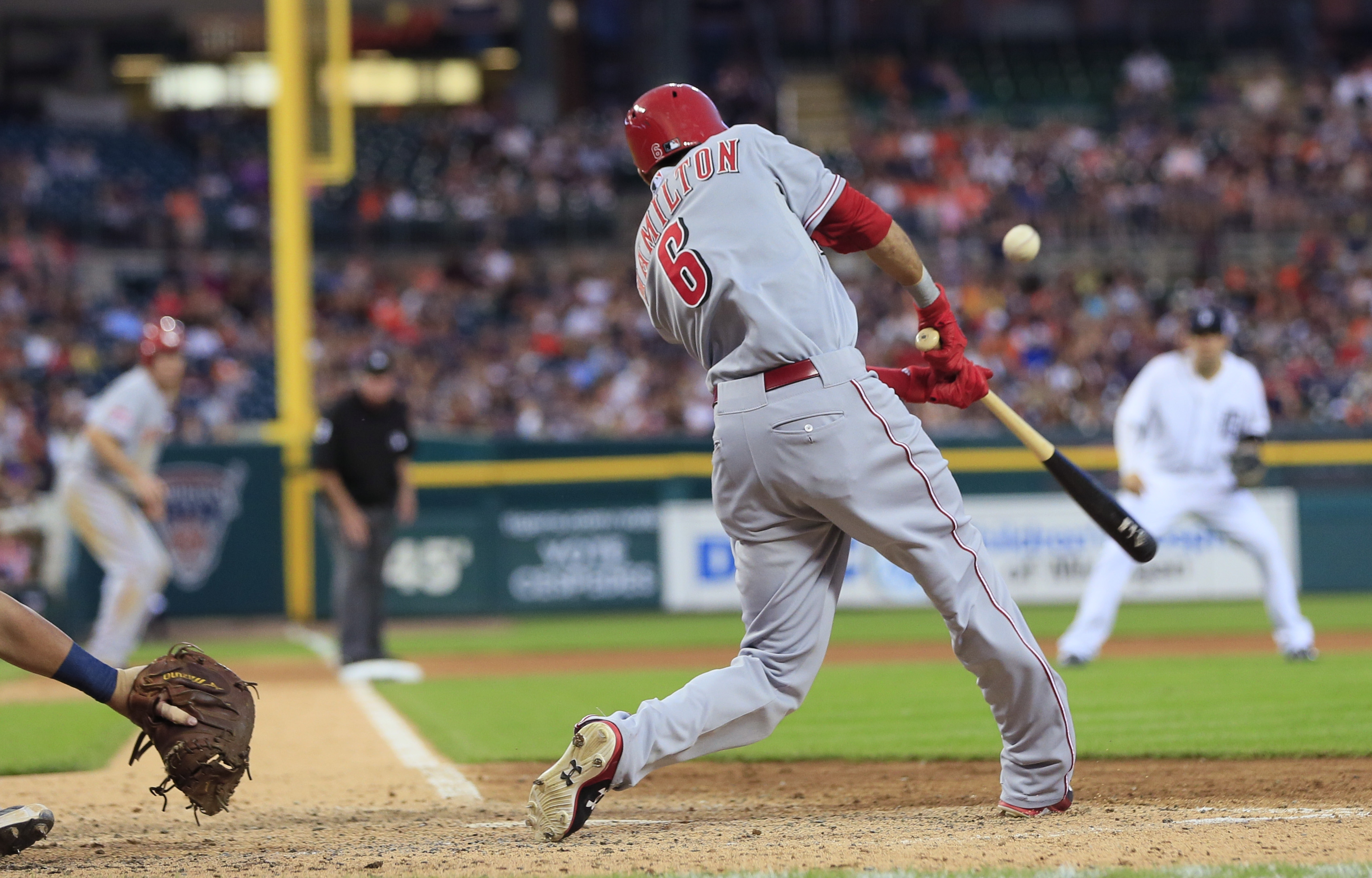 Cincinnati Reds' Billy Hamilton connects for a run scoring single to left field during the seventh inning of a baseball game against the Detroit Tigers, Tuesday, June 16, 2015, in Detroit. Jay Bruce scored for the Reds. (AP Photo/Carlos Osorio)