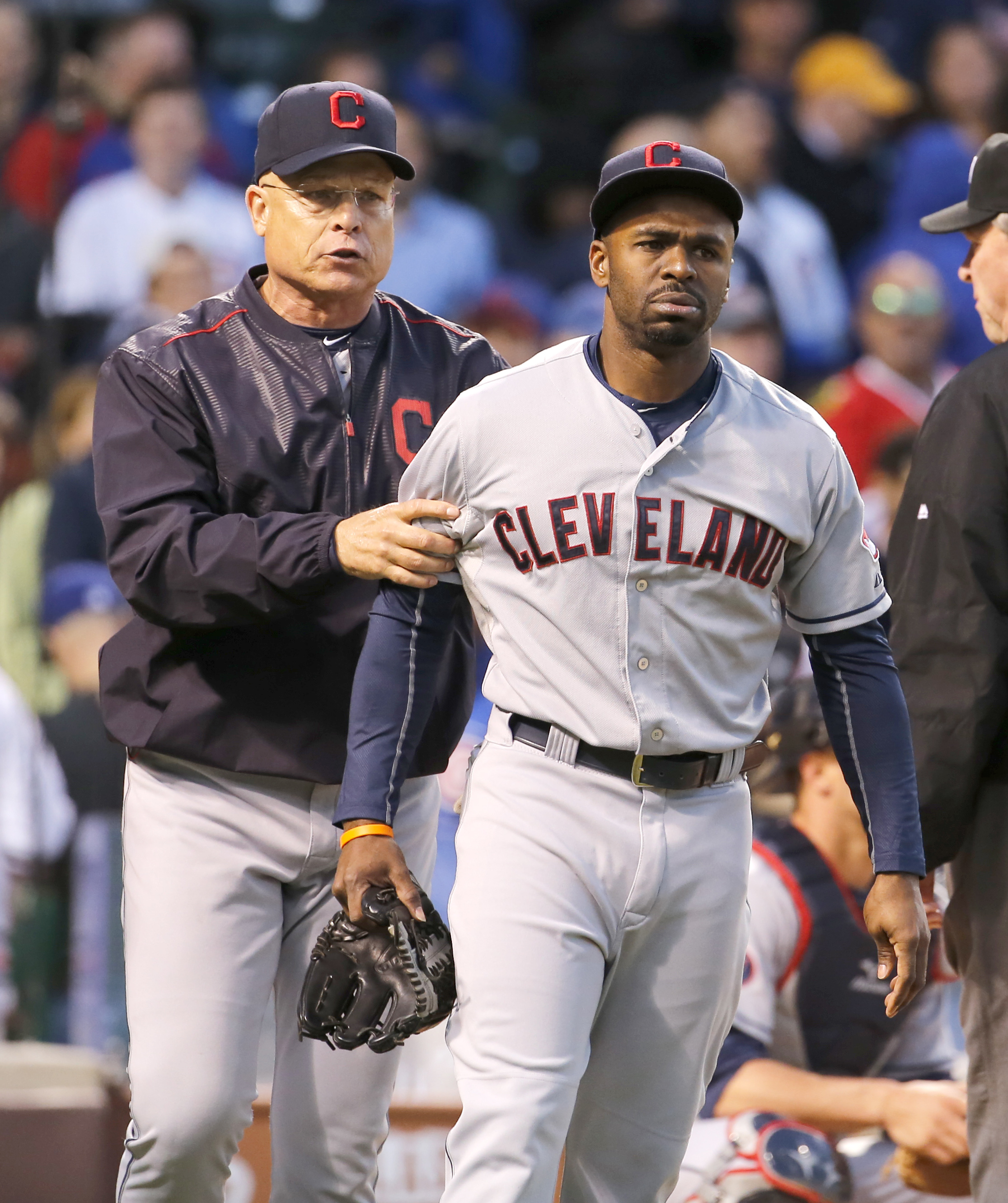 Cleveland Indians bench coach Brad Mills, left, escorts Michael Bourn off the field after Bourn was ejected from the game by home plate umpire Phil Cuzzi during the fourth inning of an interleague baseball game against the Chicago Cubs Tuesday, June 16, 2