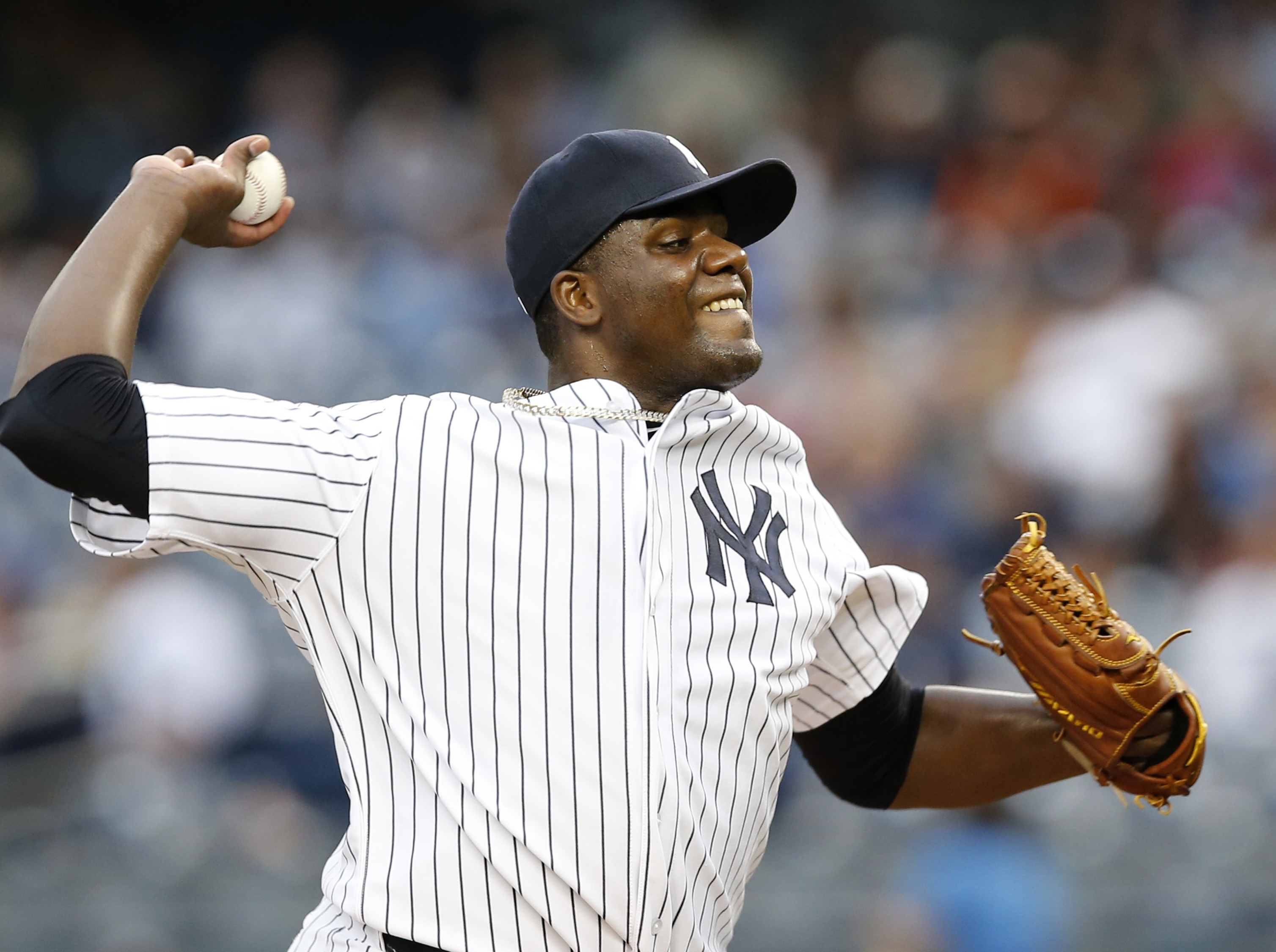 New York Yankees starting pitcher Michael Pineda delivers during the first inning of a baseball game against the Miami Marlins at Yankee Stadium in New York, Wednesday, June 17, 2015.  (AP Photo/Kathy Willens)