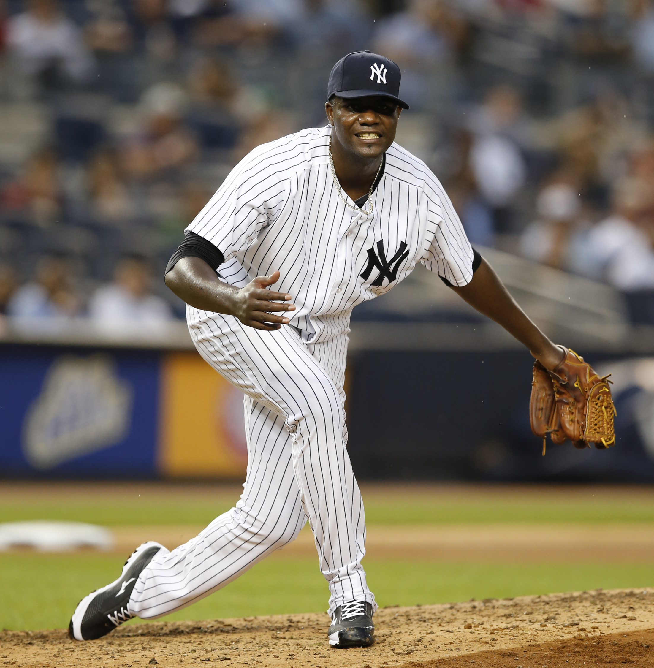 New York Yankees starting pitcher Michael Pineda (35) reacts after allowing a fourth-inning walk to Miami Marlins' Christian Yelich (21) in a baseball game at Yankee Stadium in New York, Wednesday, June 17, 2015. (AP Photo/Kathy Willens)