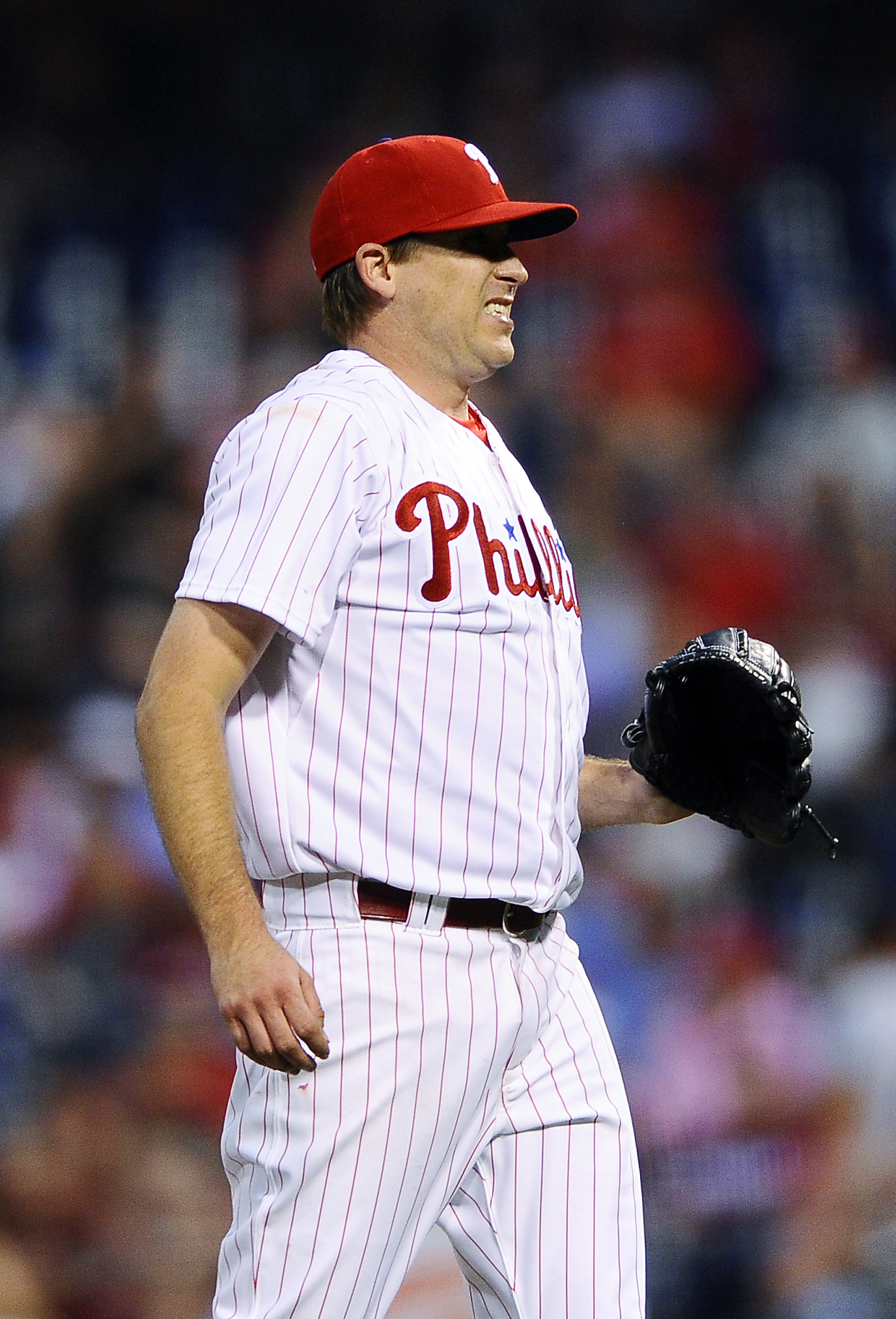 Philadelphia Phillies starting pitcher Kevin Correia reacts after giving up a solo home run to Baltimore Orioles' Travis Snider in the fourth inning of an interleague baseball game, Wednesday, June 17, 2015, in Philadelphia. (AP Photo/Michael Perez)