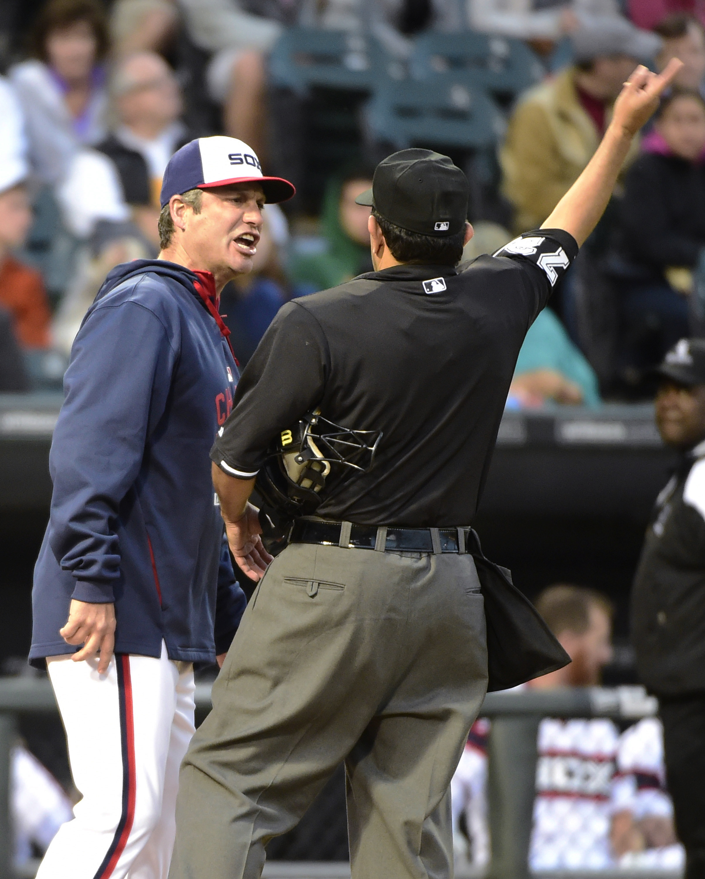 Chicago White Sox manager Robin Ventura, left, is thrown out of the game for arguing a call with home plate umpire Alfonso Marquez during the fourth inning of a baseball game against the Pittsburgh Pirates, Wednesday, June 17, 2015, in Chicago. (AP Photo/