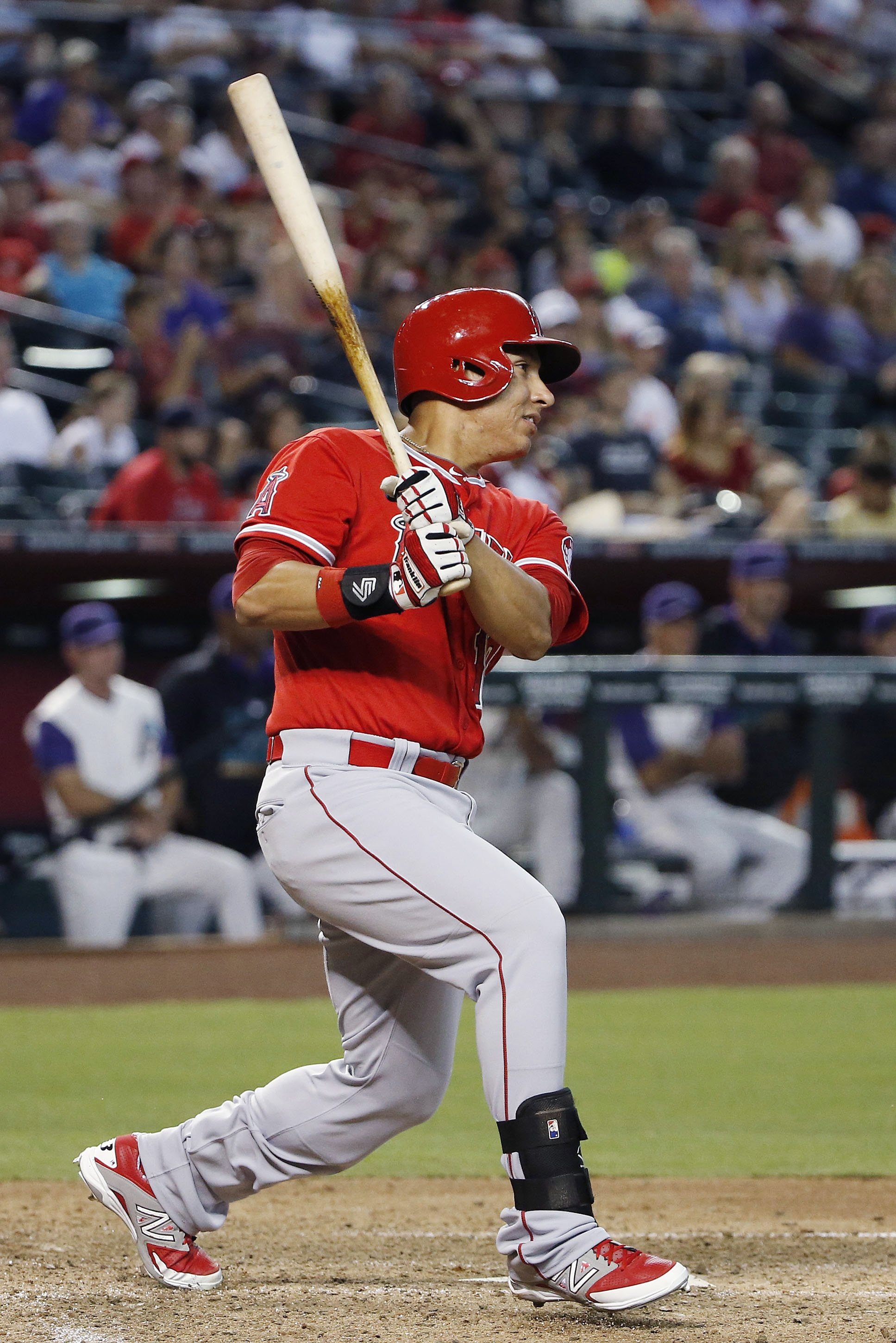 Los Angeles Angels' Efren Navarro follows through with a two-run single against the Arizona Diamondbacks during the sixth inning of a baseball game, Thursday, June 18, 2015, in Phoenix. (AP Photo/Ross D. Franklin)