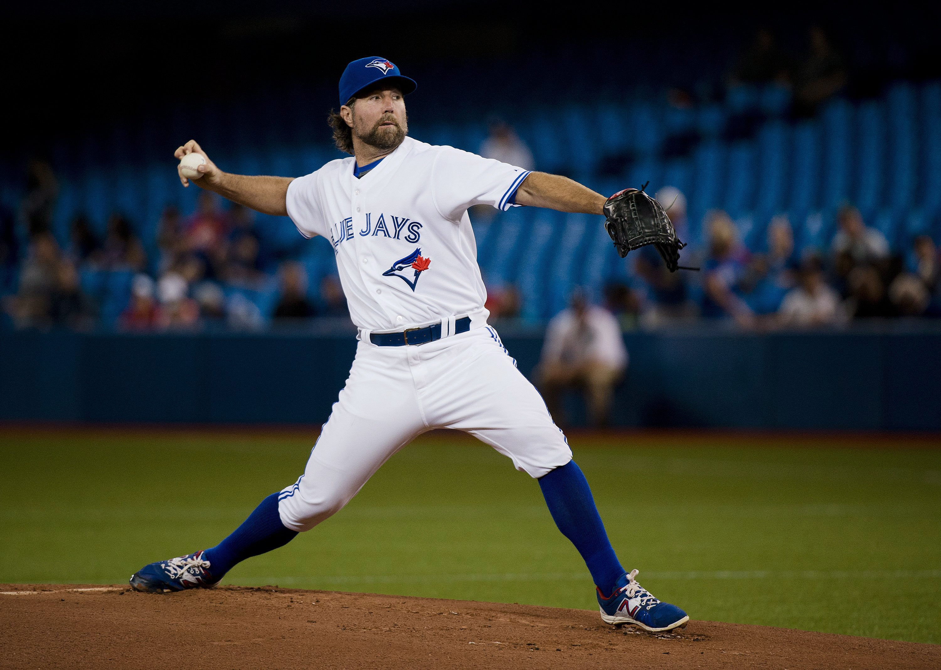 Toronto Blue Jays starting pitcher R.A. Dickey works against the New York Mets during the first inning of a baseball game Thursday, June 18, 2015, in Toronto. (Nathan Denette/The Canadian Press via AP)