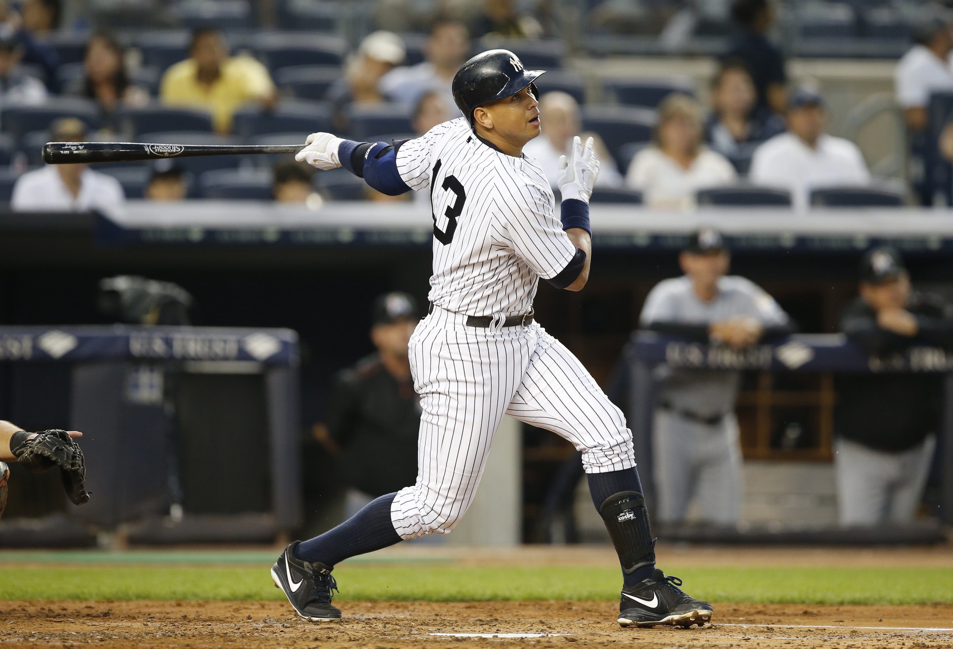 New York Yankees designated hitter Alex Rodriguez (13) watches his third-inning flyout to right field in a baseball game against the Miami Marlins at Yankee Stadium in New York, Thursday, June 18, 2015.  (AP Photo/Kathy Willens)