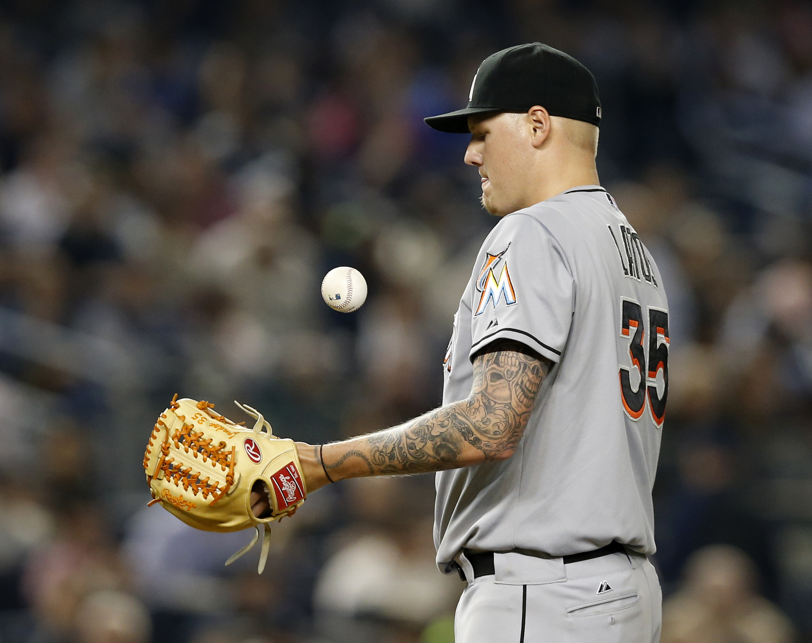 Miami Marlins starting pitcher Mat Latos (35) reacts after allowing a sixth-inning, two-run, home run to New York Yankees Brett Gardner (11) in a baseball game at Yankee Stadium in New York, Thursday, June 18, 2015.  (AP Photo/Kathy Willens)