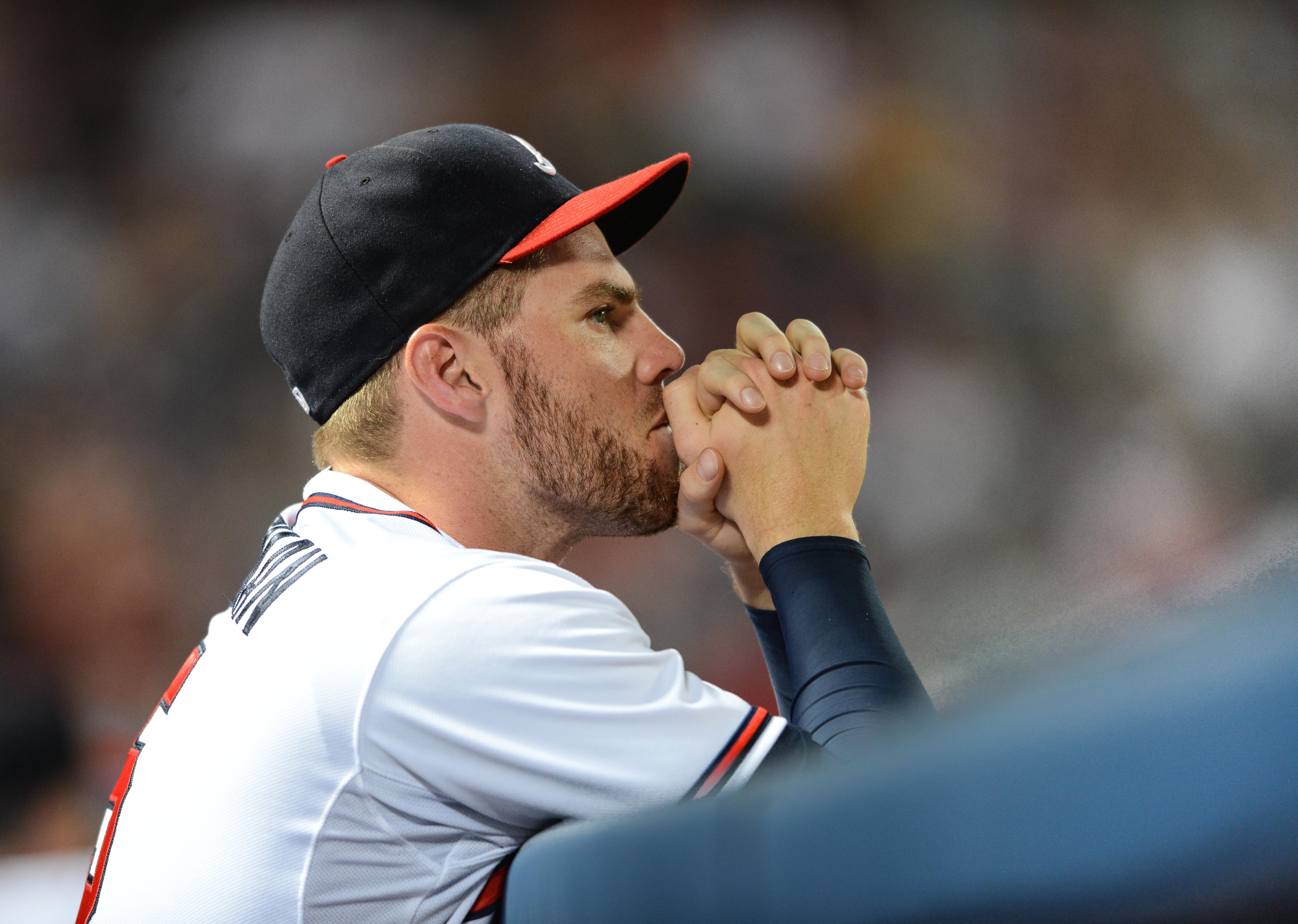 Atlanta Braves first baseman Freddie Freeman looks on from the dugout during a baseball game against the Boston Red Sox Thursday, June 18, 2015, in Atlanta.  Freeman sat out for the first time in three seasons, ending his consecutive games playing streak