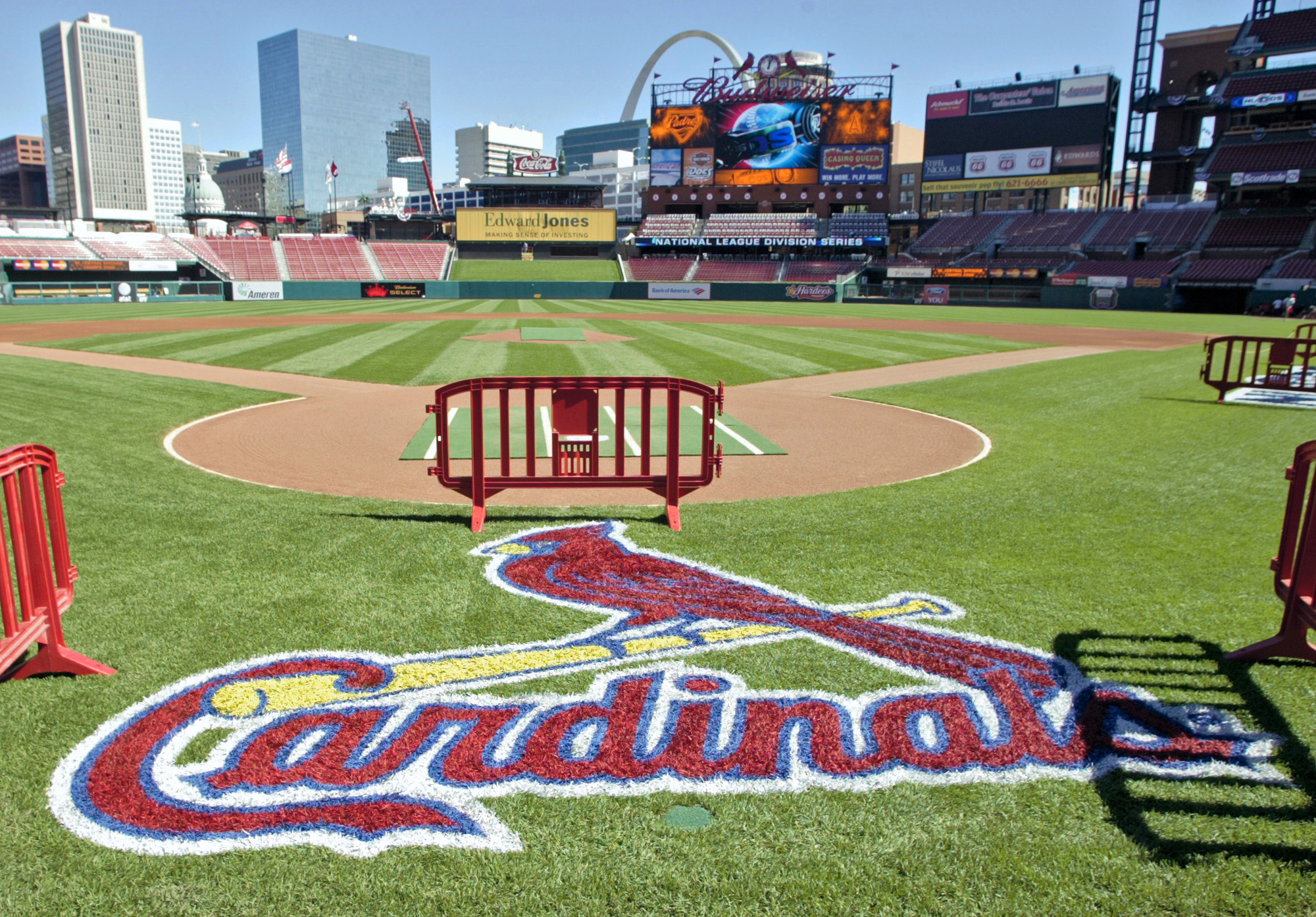FILE - In this Oct. 6, 2006 file photo, a freshly painted St. Louis Cardinals logo adorns the grass behind home plate at Busch Stadium in St. Louis. The St. Louis Cardinals have been the toast of their Midwestern town for generations, a source of civic pr