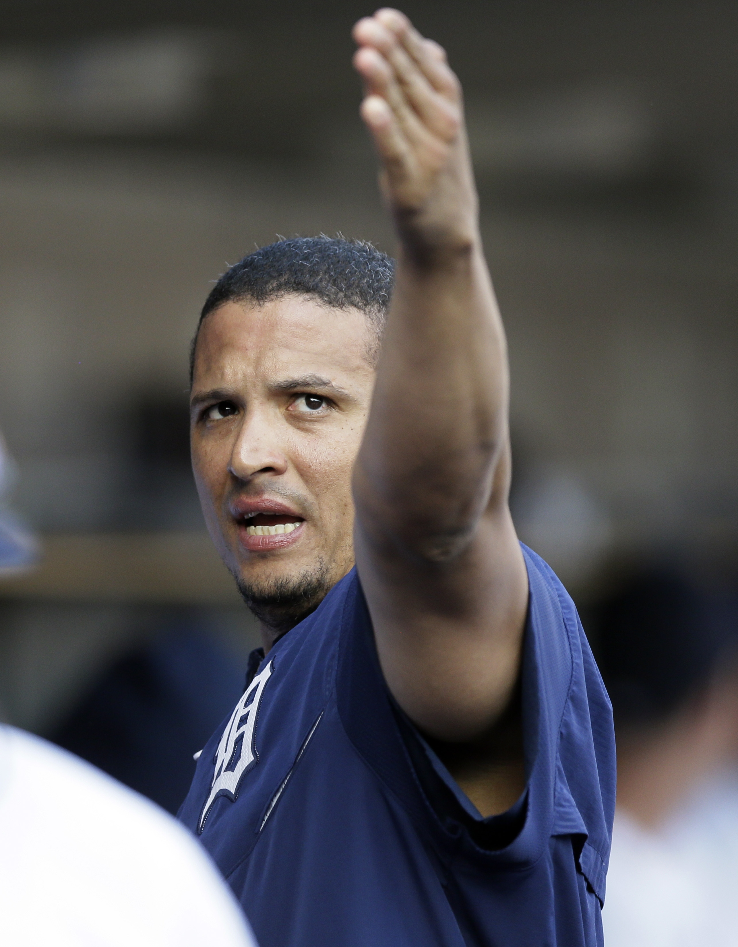 Detroit Tigers designated hitter Victor Martinez talks to a teammate before the first inning of a baseball game against the Chicago Cubs, Wednesday, June 10, 2015, in Detroit. (AP Photo/Carlos Osorio)
