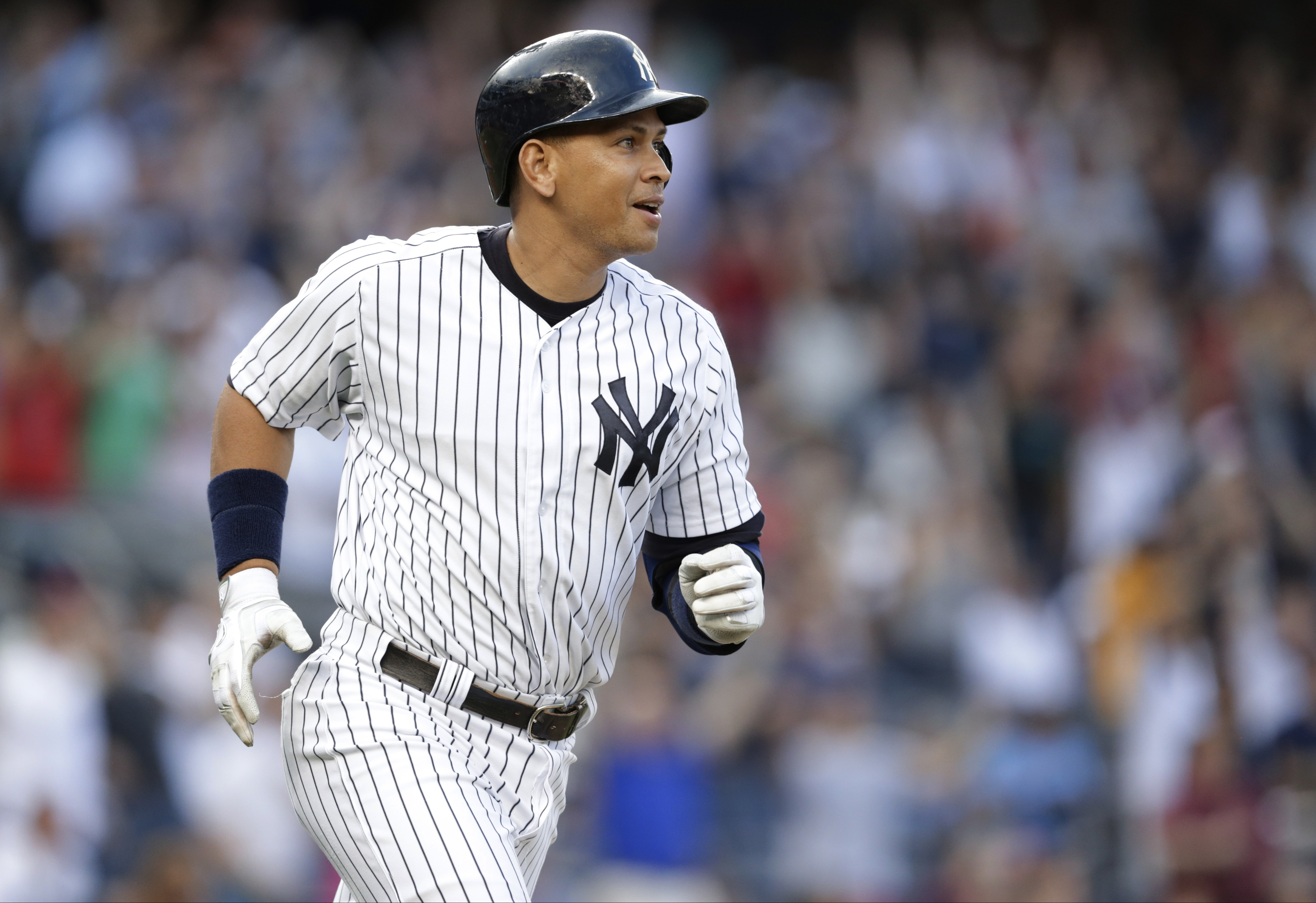 New York Yankees' Alex Rodriguez watches his home run, his 3,000th career hit, during the first inning of a baseball game against the Detroit Tigers on Friday, June 19, 2015, in New York. (AP Photo/Frank Franklin II)