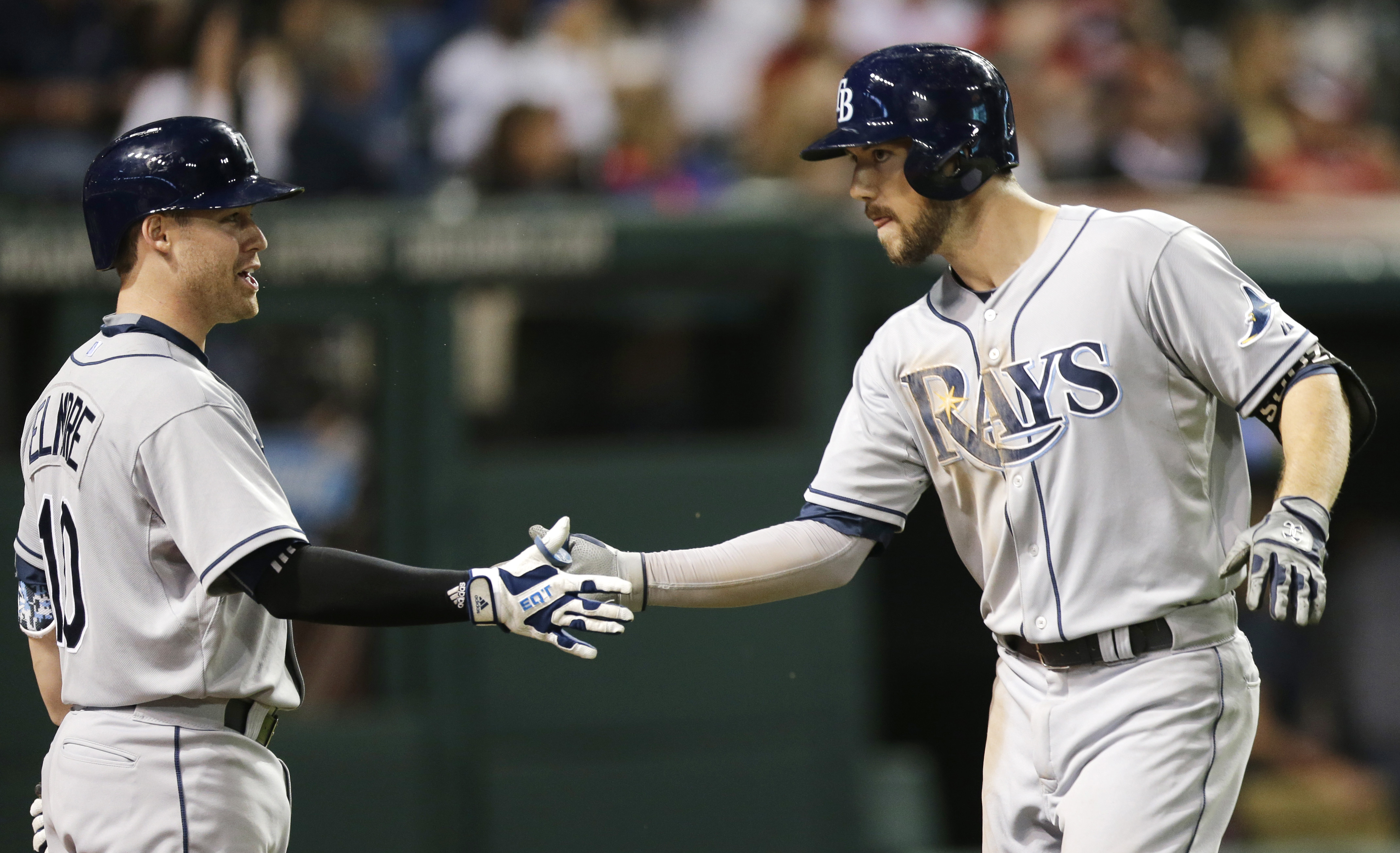 Tampa Bay Rays' Steven Souza Jr., right, is congratulated by Jake Elmore after Souza hit a solo home run off Cleveland Indians relief pitcher Scott Atchison in the ninth inning of a baseball game, Friday, June 19, 2015, in Cleveland. (AP Photo/Tony Dejak)