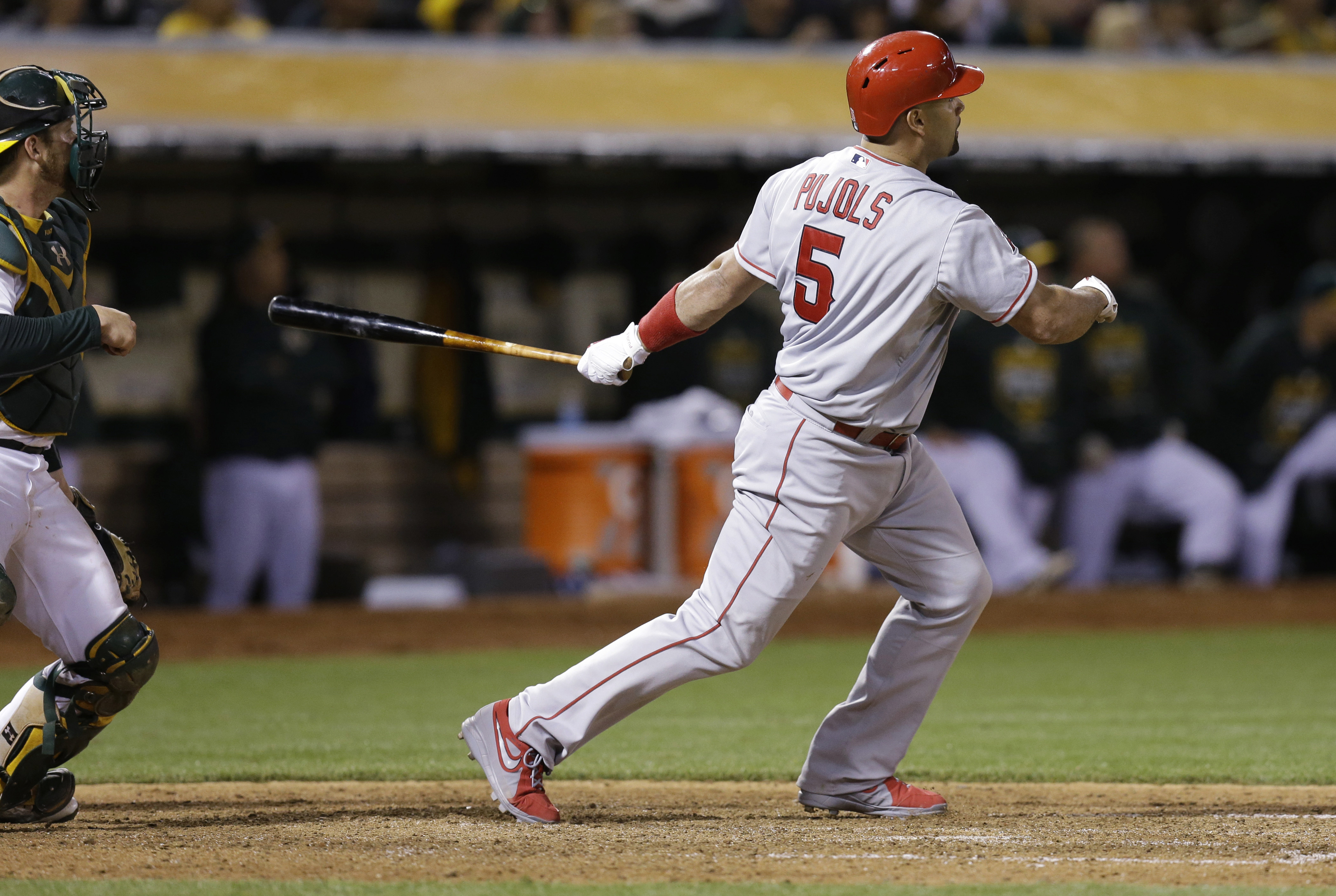 Los Angeles Angels' Albert Pujols watches his grand slam off Oakland Athletics' Edward Mujica during the seventh inning of a baseball game Friday, June 19, 2015, in Oakland, Calif. (AP Photo/Ben Margot)