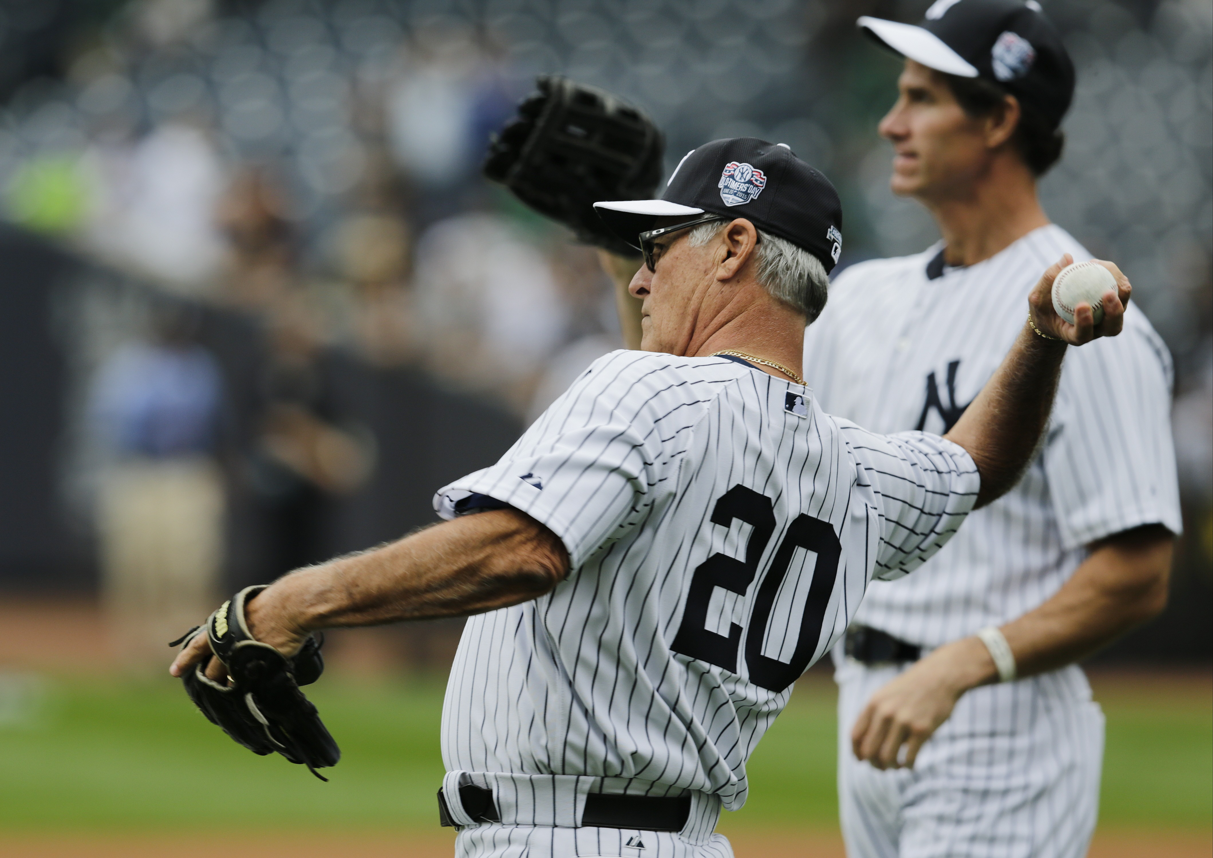 Former New York Yankees player Bucky Dent (20) throws a ball while warming up before the Old-Timers' Day baseball game Saturday, June 20, 2015, in New York. (AP Photo/Frank Franklin II)