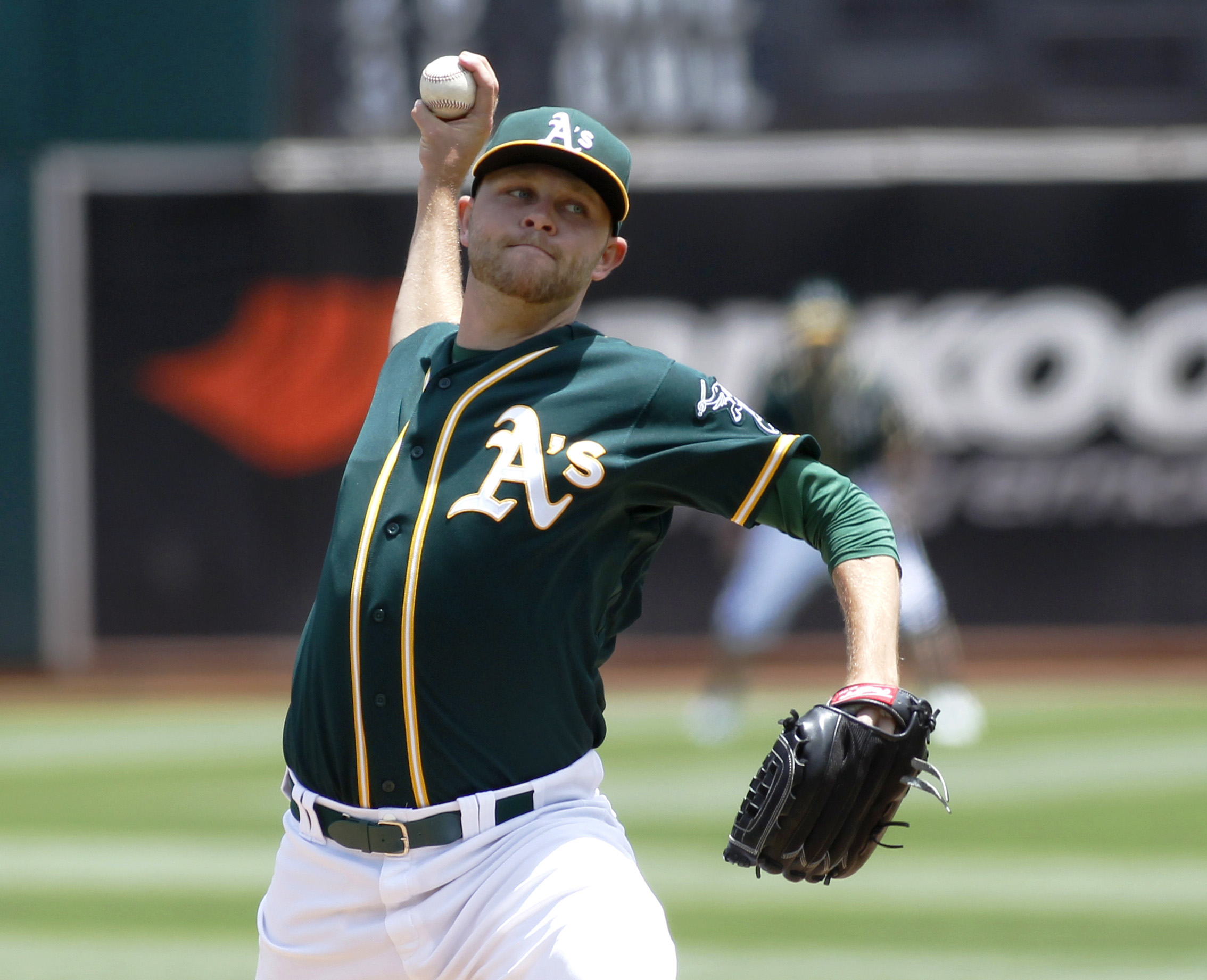 Oakland Athletics pitcher Jesse Hahn throws to the Los Angeles Angels during the first inning of a baseball game, Saturday, June 20, 2015, in Oakland, Calif.  (AP Photo/George Nikitin)