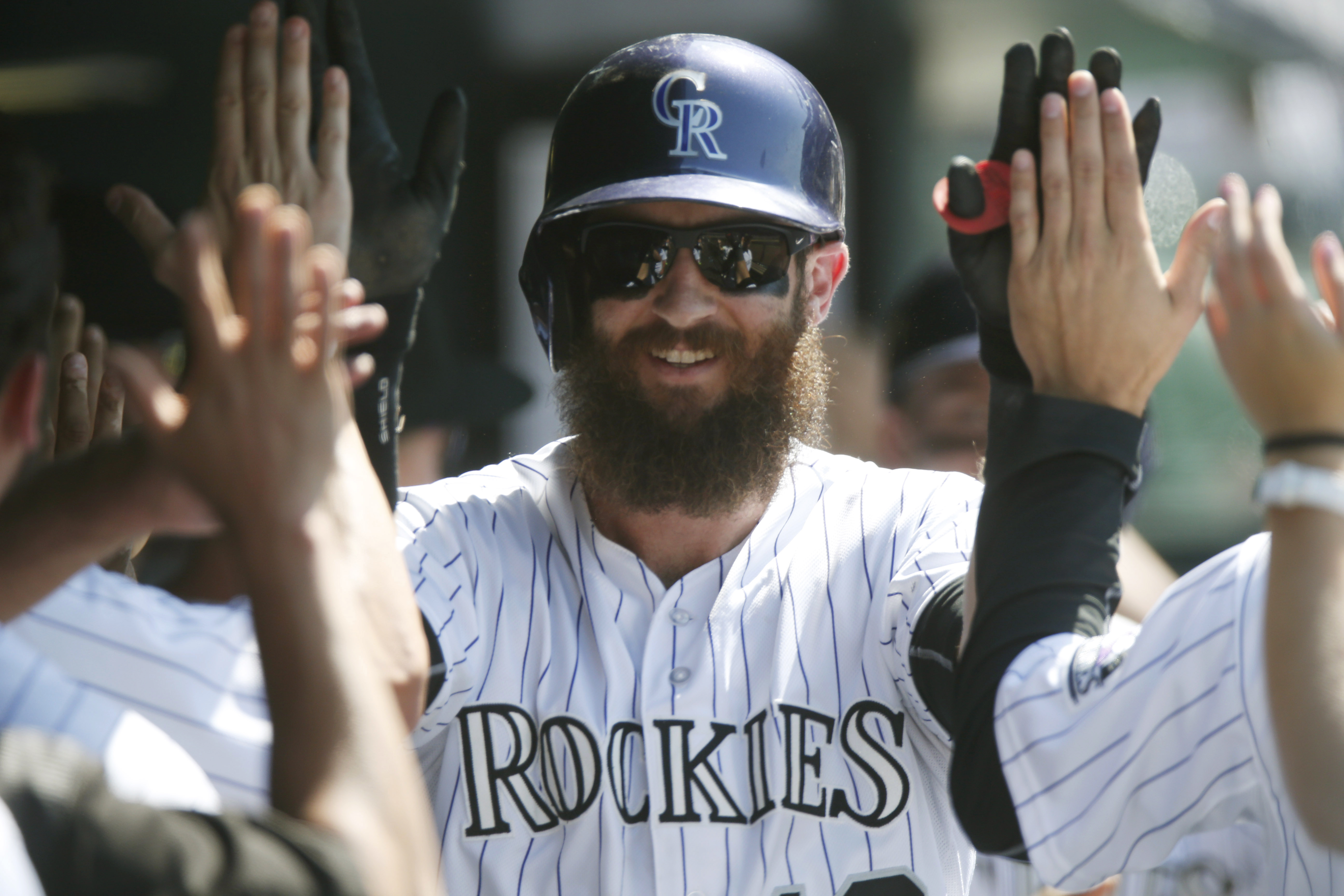 Colorado Rockies' Charlie Blackmon is congratulated by teammates after hitting a two-run home run off Milwaukee Brewers starting pitcher Kyle Lohse in the fifth inning of a baseball game Saturday, June 20, 2015, in Denver. (AP Photo/David Zalubowski)