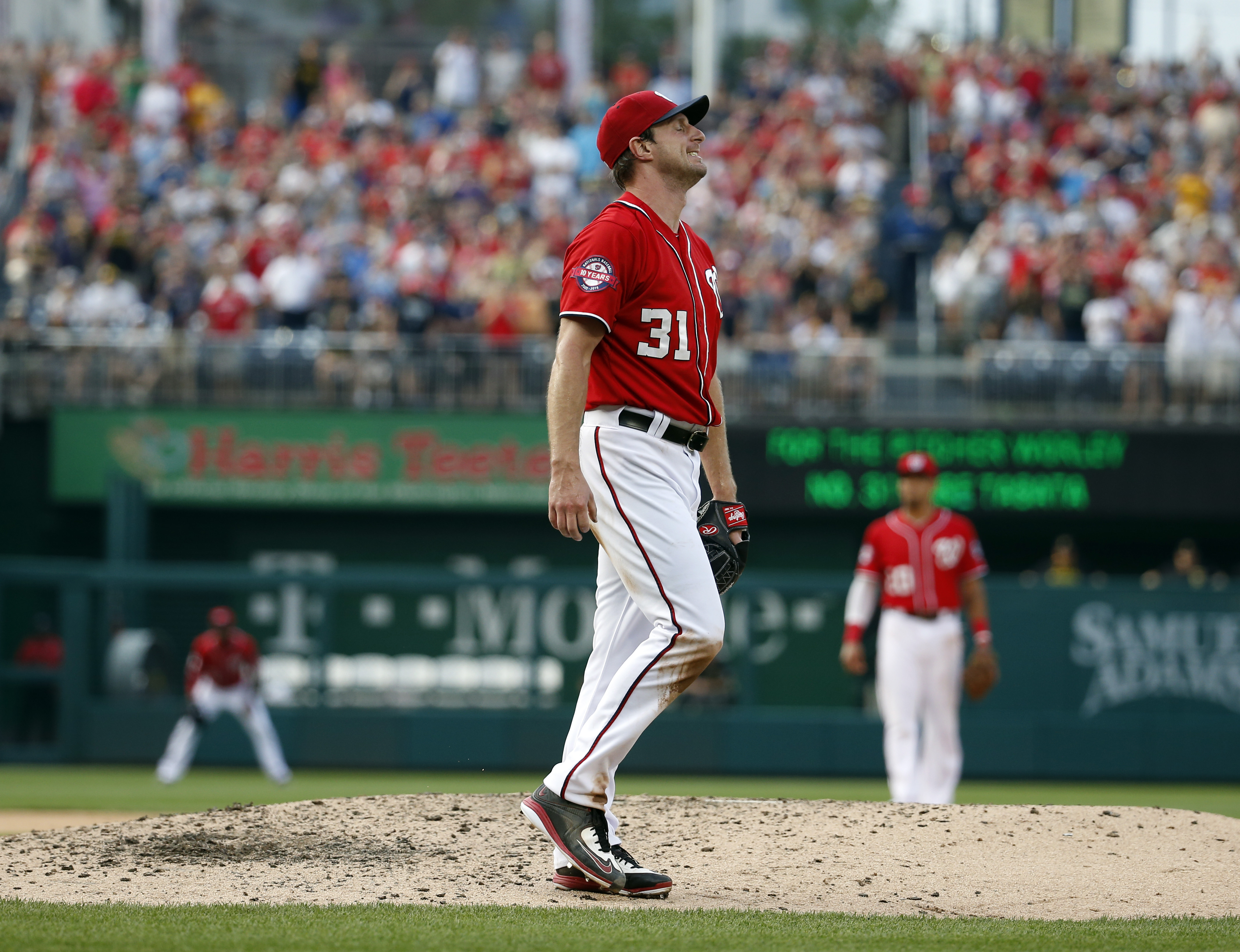 Washington Nationals starting pitcher Max Scherzer reacts after hitting Pittsburgh Pirates pinch hitter Jose Tabata during the ninth inning of a baseball game at Nationals Park, Saturday, June 20, 2015, in Washington. Scherzer threw a no-hitter and the Na