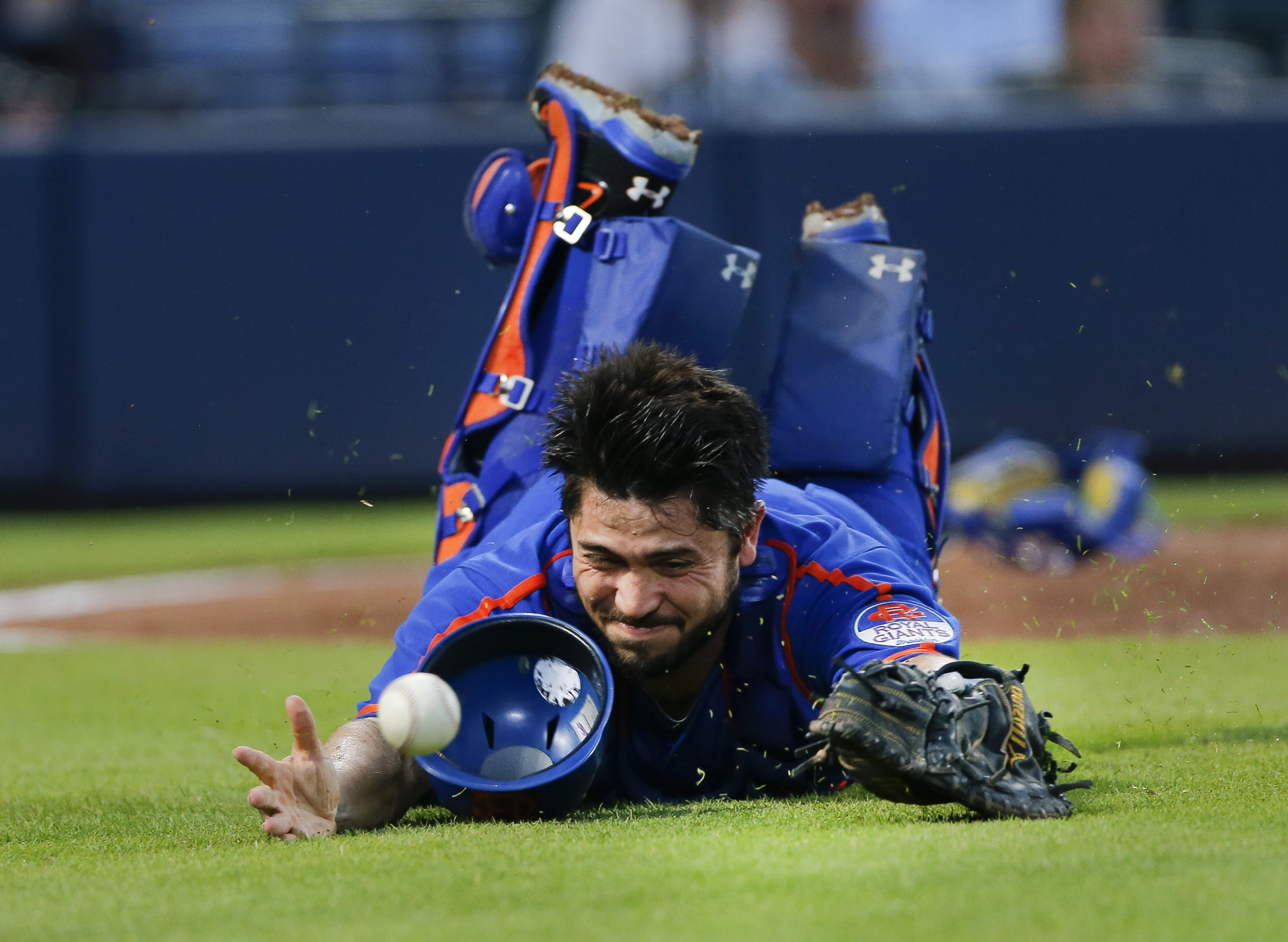 New York Mets catcher Travis d'Arnaud (7) can't reach a ball bunted foul by Atlanta Braves pitcher Williams Perez in the fourth inning of a baseball game Saturday, June 20, 2015, in Atlanta.  (AP Photo/John Bazemore)