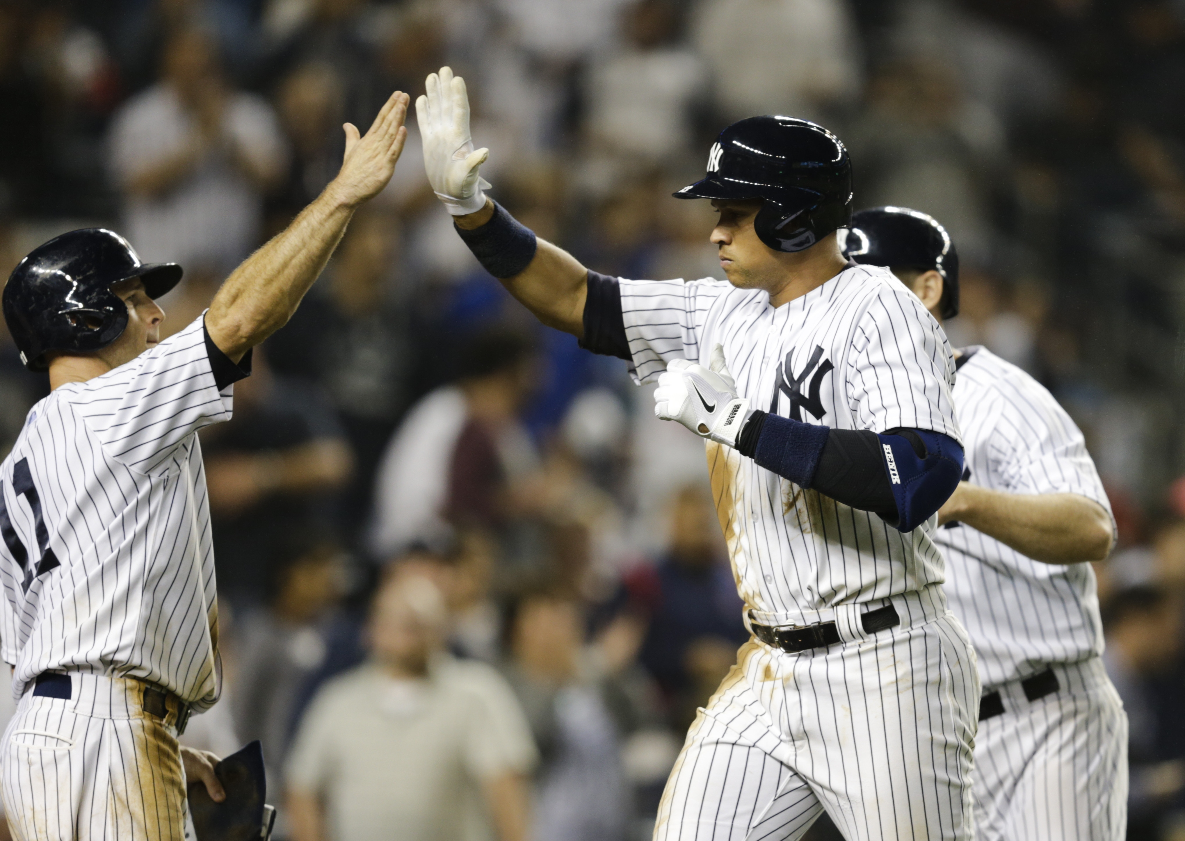New York Yankees' Alex Rodriguez (13) celebrates with Brett Gardner (11) after Rodriguez hit a three run home run during the third inning of a baseball game against the Detroit Tigers Saturday, June 20, 2015, at Yankee Stadium in New York. (AP Photo/Frank