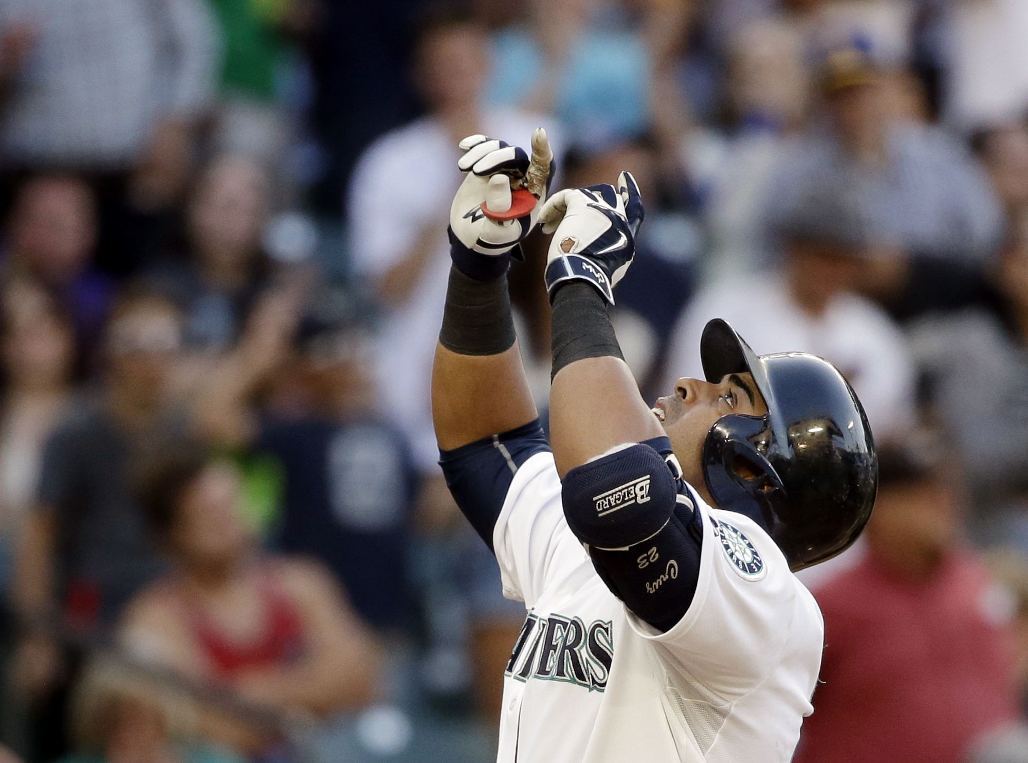Seattle Mariners' Nelson Cruz points skyward as he crosses home on his home run against the Houston Astros during the third inning of a baseball game Saturday, June 20, 2015, in Seattle. (AP Photo/Elaine Thompson)