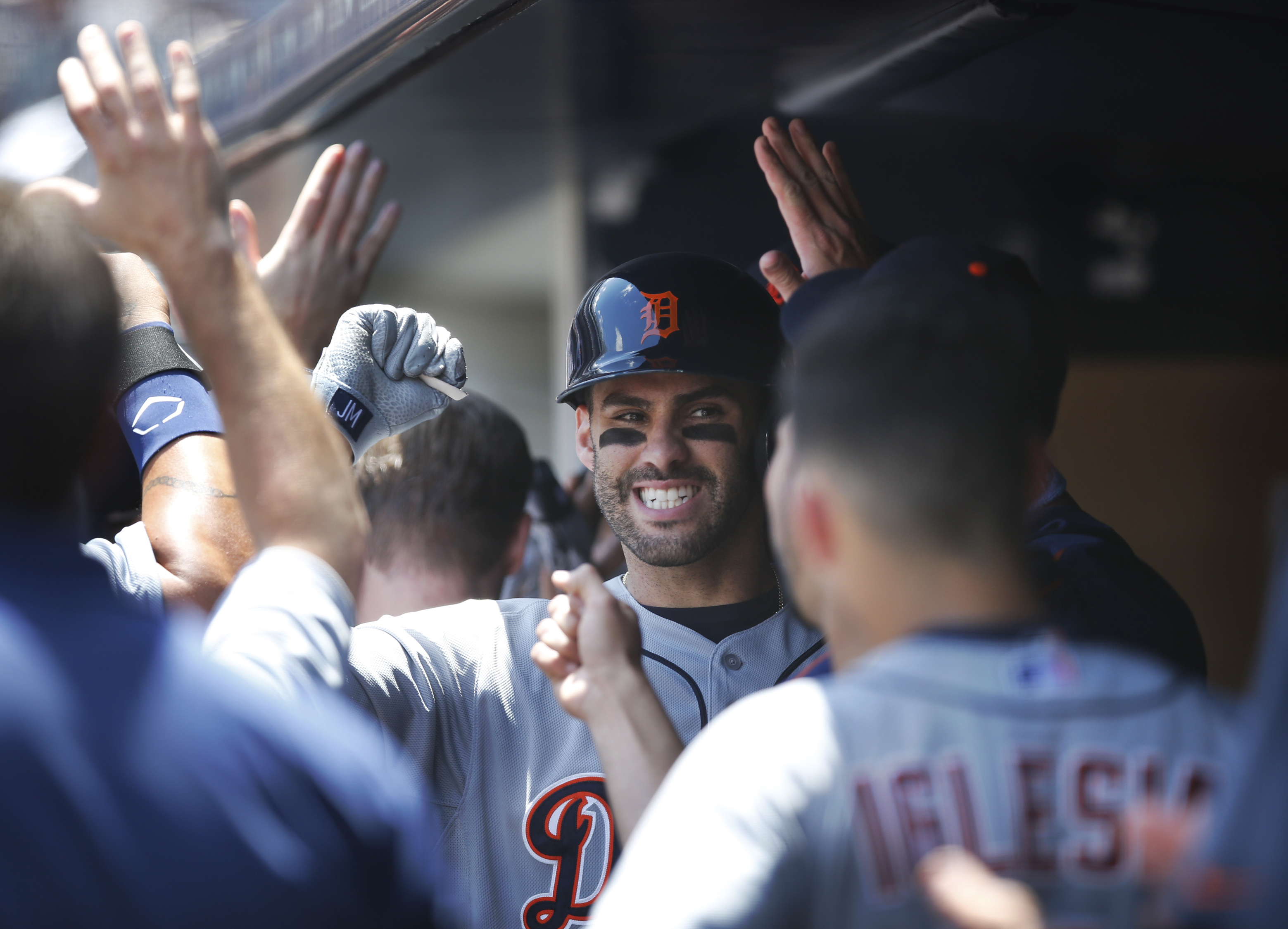 Teammates congratulate Detroit Tigers J.D. Martinez, center, after he hit a first-inning, two-run home run off New York Yankees starting pitcher Masahiro Tanaka in a baseball game at Yankee Stadium in New York, Sunday, June 21, 2015. (AP Photo/Kathy Wille