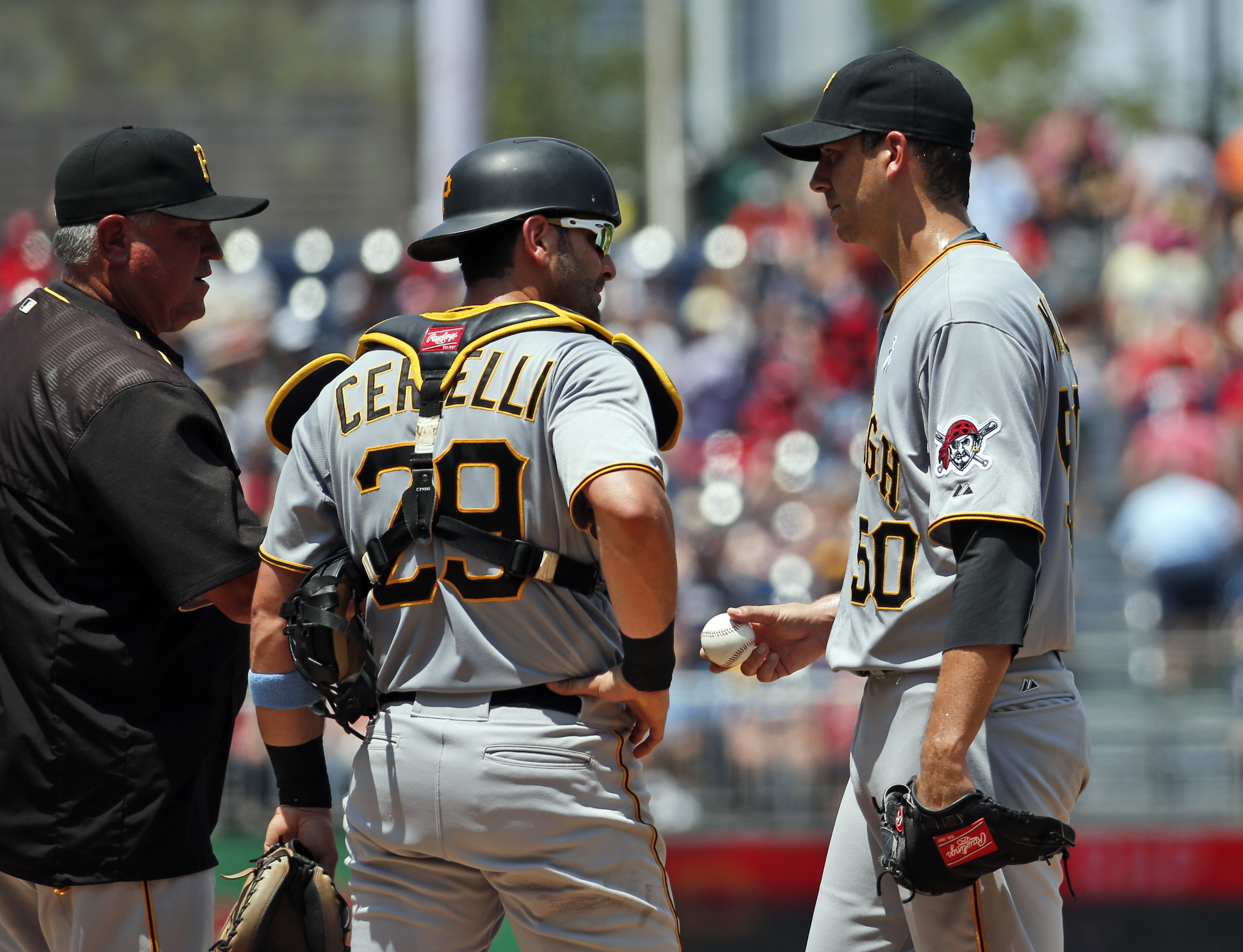 Pittsburgh Pirates manager Clint Hurdle, left, relieves starting pitcher Charlie Morton (50) with catcher Francisco Cervelli (29) nearby, during the first inning of a baseball game against the Washington Nationals at Nationals Park, Sunday, June 21, 2015,