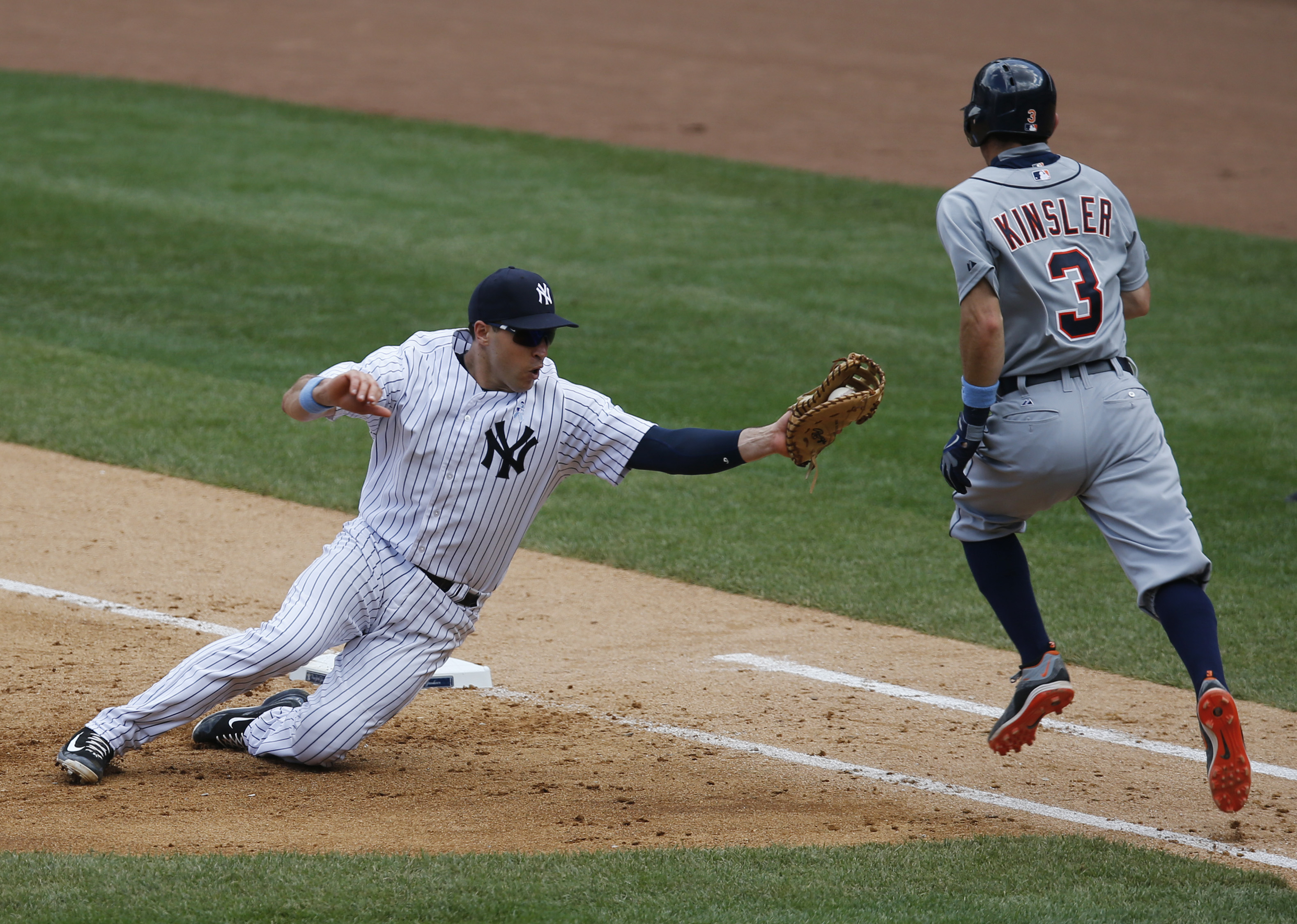 New York Yankees first baseman Mark Teixeira (25) prepares to tag Detroit Tigers Ian Kinsler (3) on a sixth-inning groundout in a baseball game at Yankee Stadium in New York, Sunday, June 21, 2015.  (AP Photo/Kathy Willens)