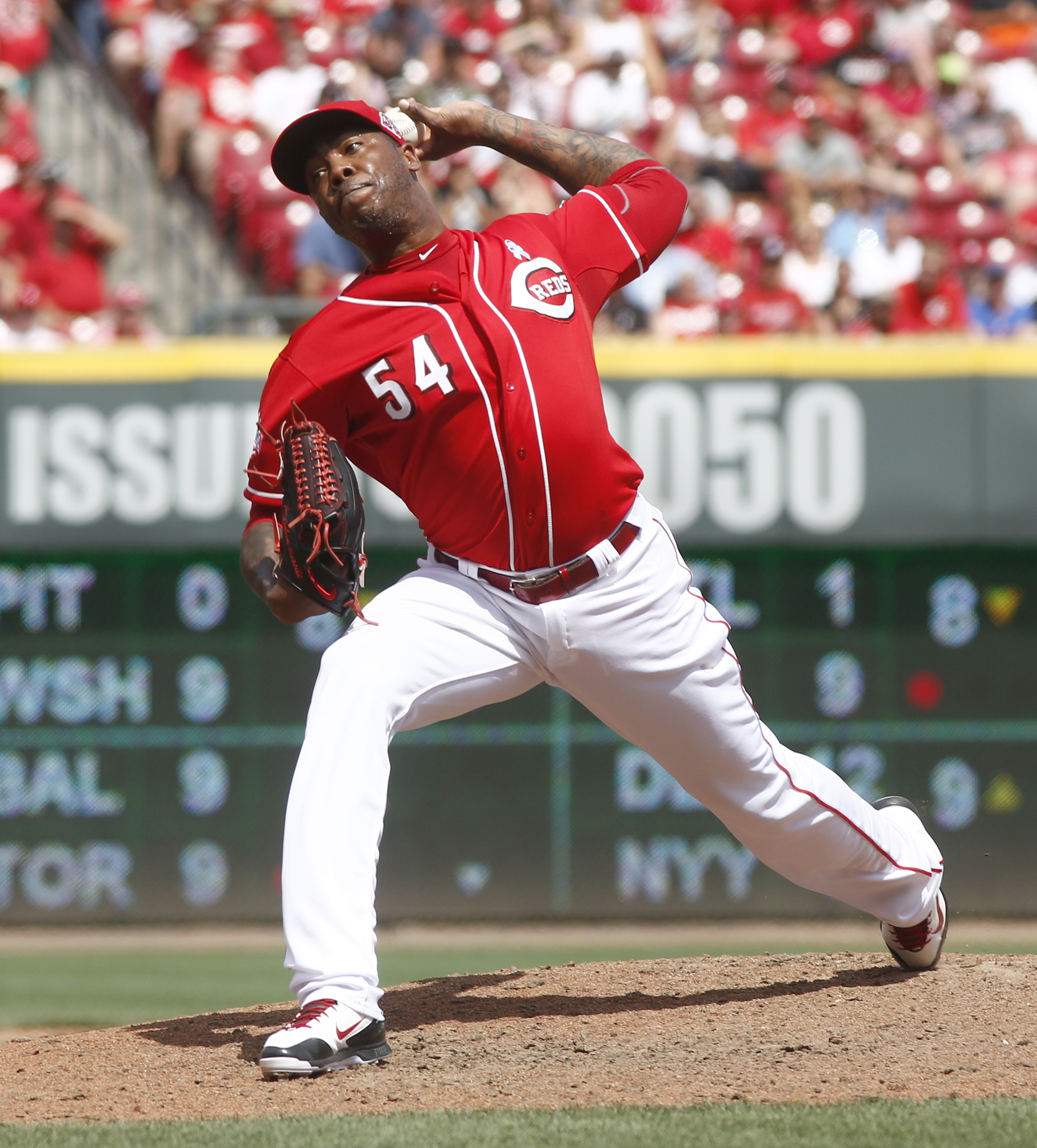 Cincinnati Reds relief pitcher Aroldis Chapman throws against the Miami Marlins in the ninth inning of a baseball game, Sunday, June 21, 2015, in Cincinnati. The Reds won 5-2. (AP Photo/David Kohl)