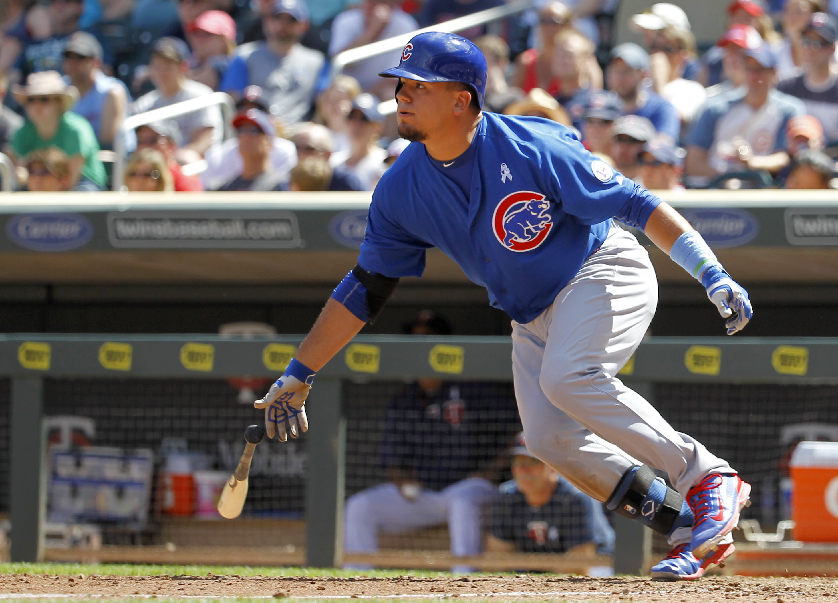 Chicago Cubs designated hitter Kyle Schwarber watches the flight of his two-run single off Minnesota Twins relief pitcher Aaron Thompson during the eighth inning of a baseball game in Minneapolis, Sunday, June 21, 2015. The Cubs won 8-0. (AP Photo/Ann Hei