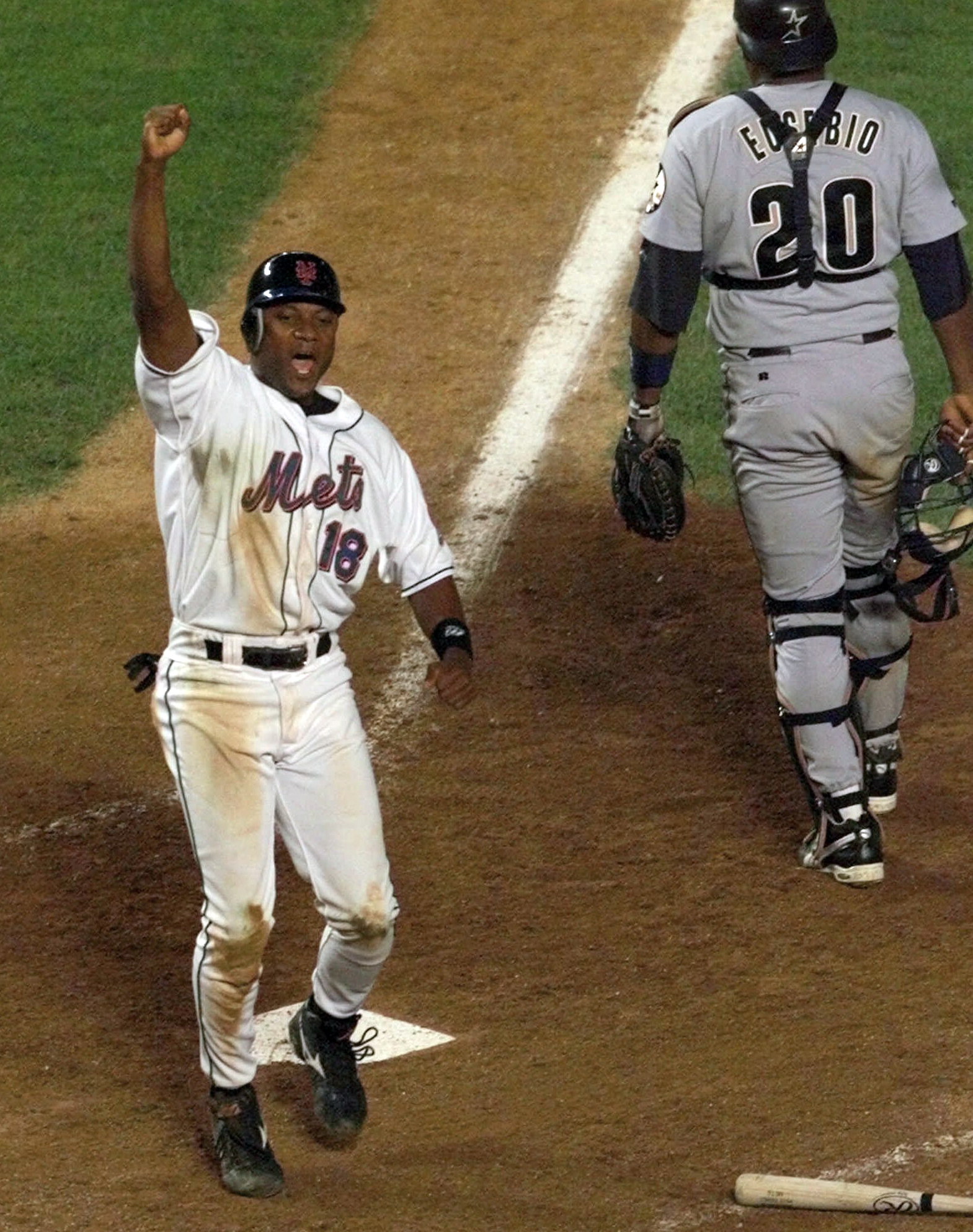FILE - In this Aug. 23, 1999, file photo, New York Mets' Darryl Hamilton celebrates as he scores the game-winning run on a Matt Franco hit to left field in the bottom of the ninth inning that gave the Mets a 3-2 victory over the Houston Astros in a baseba