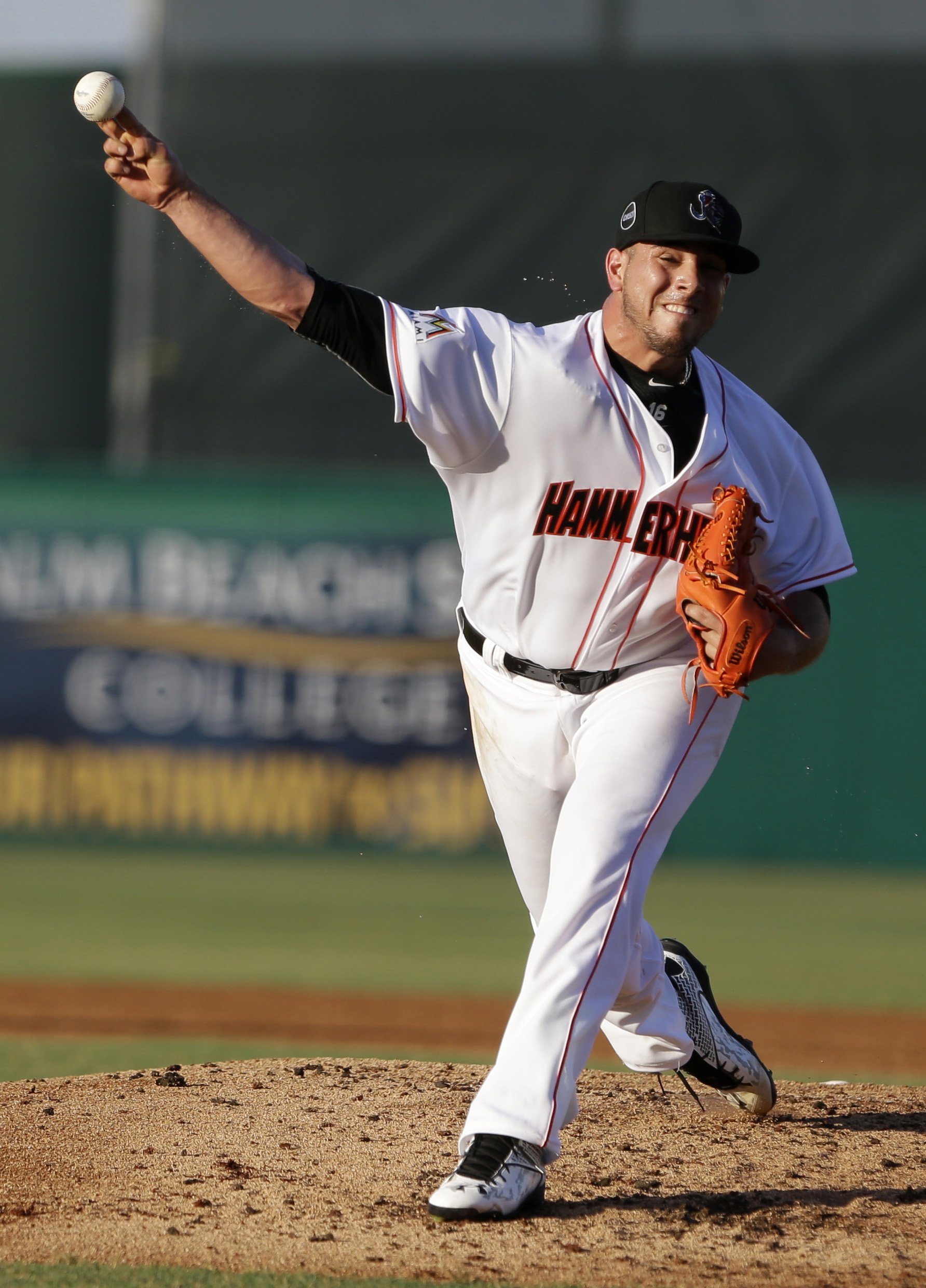 Miami Marlins' Jose Fernandez delivers a pitch during the second inning of a minor-league baseball game between the Jupiter Hammerheads and the St. Lucie Mets, Monday, June 22, 2015, in Jupiter, Fla. Fernandez had his biggest test yet in the rehab process