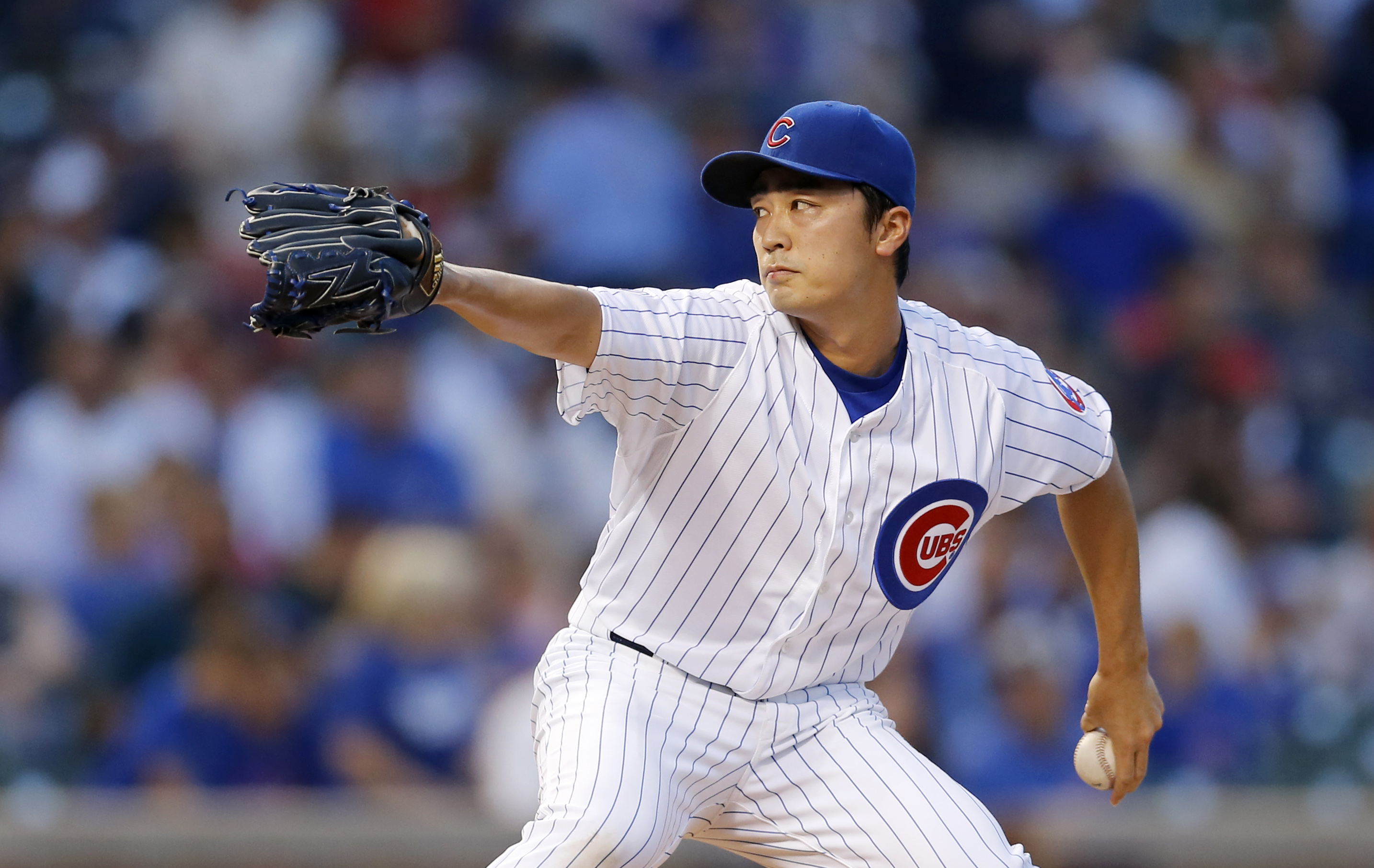 Chicago Cubs starting pitcher Tsuyoshi Wada delivers during the first inning of a baseball game against the Los Angeles Dodgers Monday, June 22, 2015, in Chicago. (AP Photo/Charles Rex Arbogast)