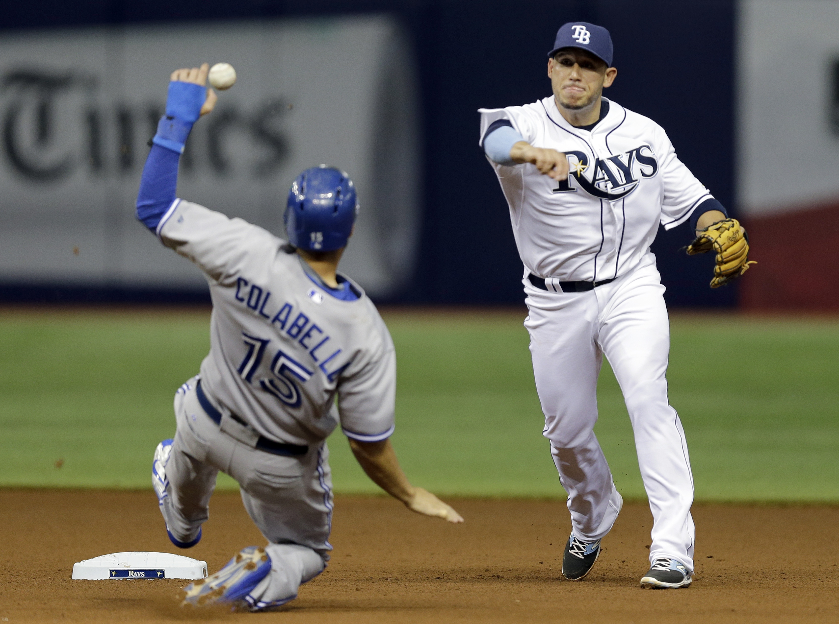 Tampa Bay Rays shortstop Asdrubal Cabrera, right, forces Toronto Blue Jays' Chris Colabello at second base and relays the throw to first base in time to turn a double play on Ezequiel Carrera during the fourth inning of a baseball game Monday, June 22, 20