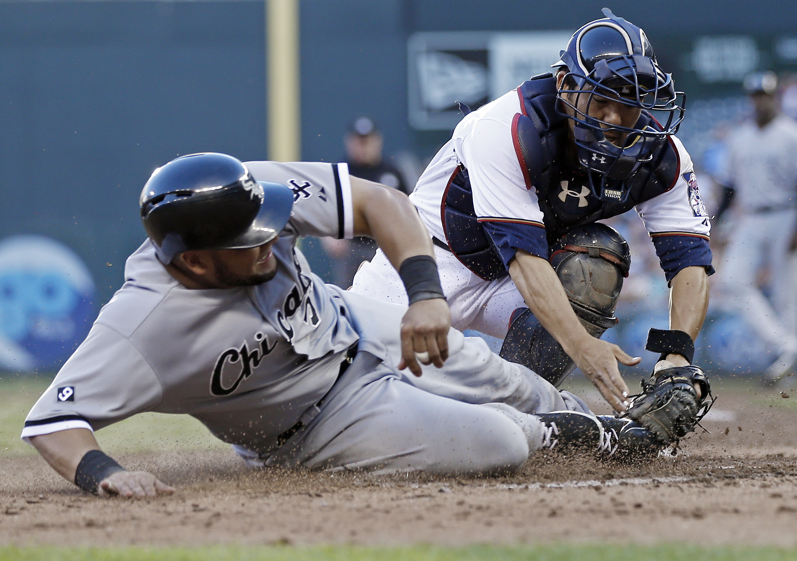 Chicago White Sox left fielder Melky Cabrera, left, is tagged out by Minnesota Twins catcher Kurt Suzuki as he tried to score on a single by Alexei Ramirez in the third inning of a baseball game, Monday, June 22, 2015, in Minneapolis. (AP Photo/Jim Mone)