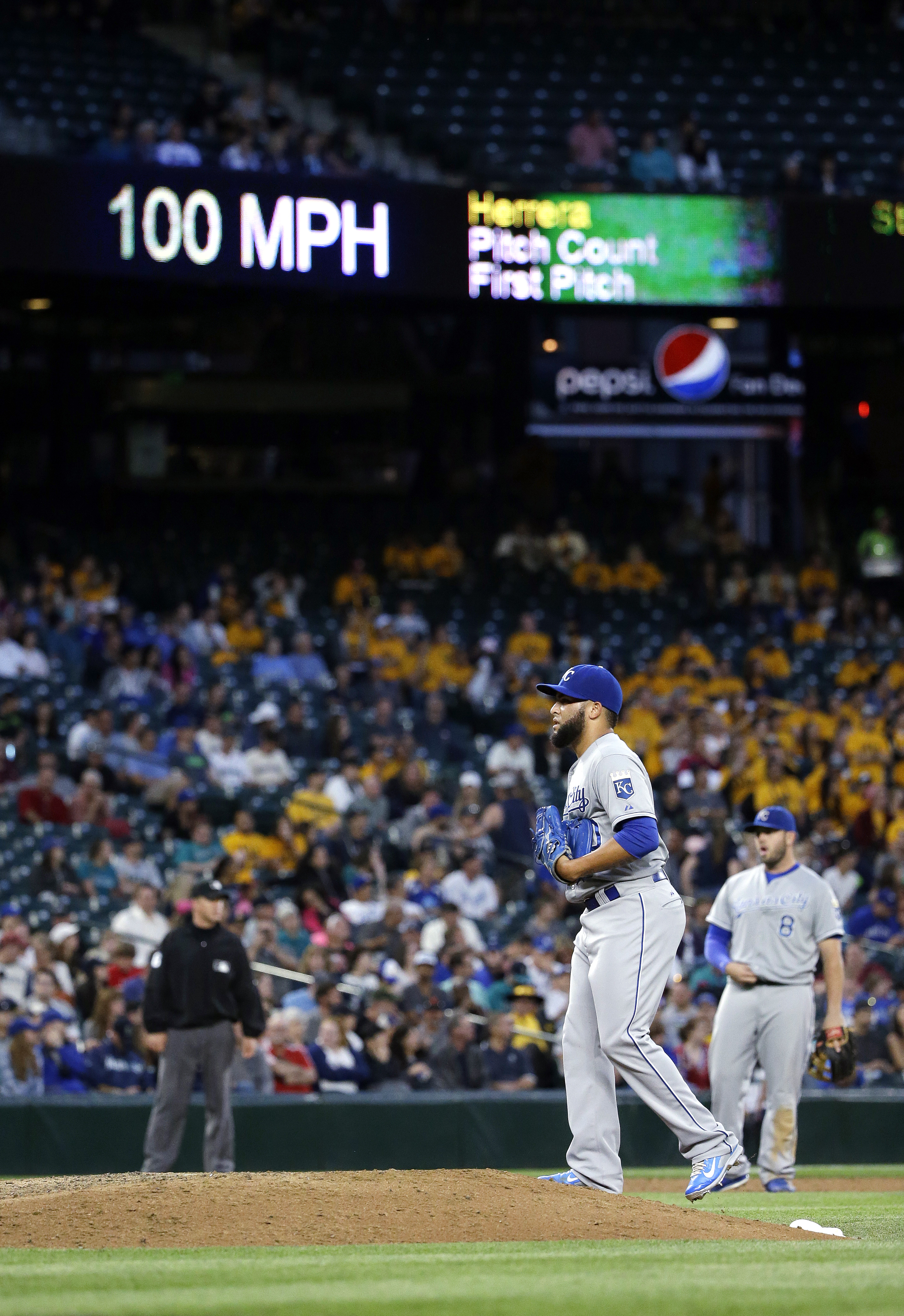Kansas City Royals relief pitcher Kelvin Herrera walks back to the mound after throwing a 100-mph fastball against the Seattle Mariners in the seventh inning of a baseball game Monday, June 22, 2015, in Seattle. (AP Photo/Elaine Thompson)