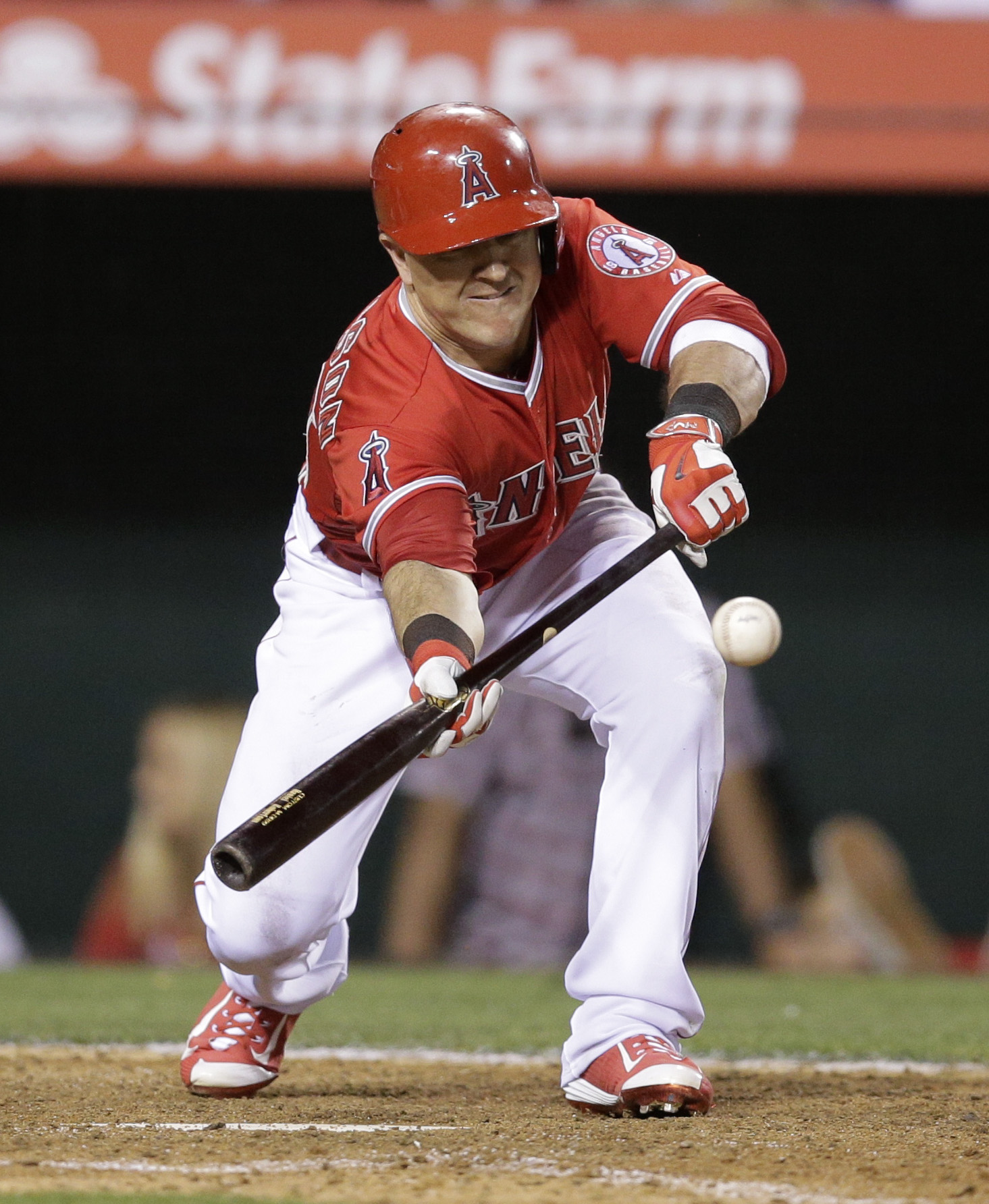 Los Angeles Angels' Daniel Robertson hits a sacrifice bunt during the eighth inning of a baseball game against the Houston Astros, Monday, June 22, 2015, in Anaheim, Calif. Erick Aybar scored on the play. (AP Photo/Jae C. Hong)