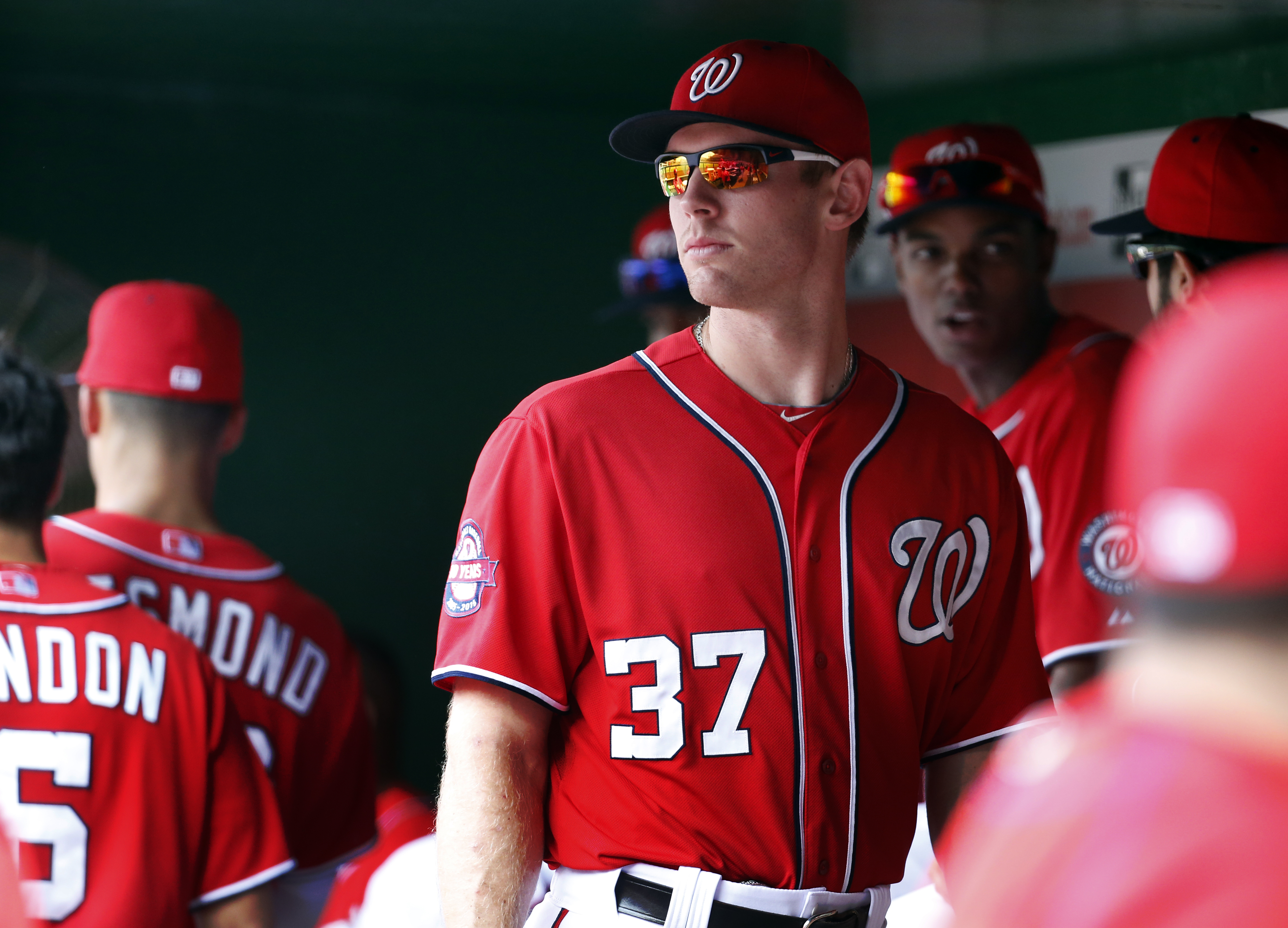 Washington Nationals starting pitcher Stephen Strasburg (37) stands in the dugout before a baseball game against the Pittsburgh Pirates at Nationals Park, Saturday, June 20, 2015, in Washington. (AP Photo/Alex Brandon)