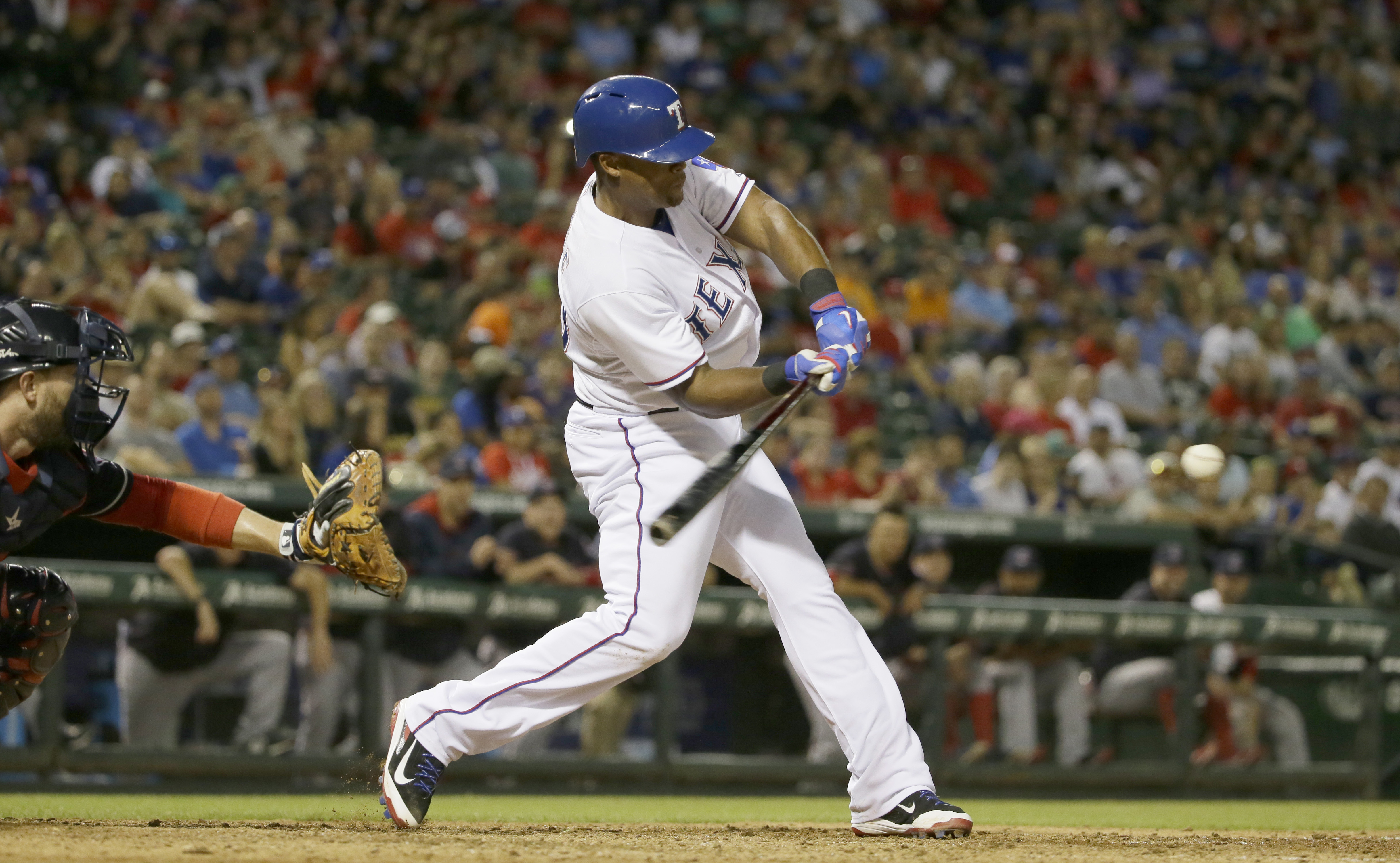 Texas Rangers Adrian Beltre, right, turns on the ball in front of Cleveland Indians catcher Brett Hayes during the seventh inning of a baseball game in Arlington, Texas, Friday, May 15, 2015. (AP Photo/LM Otero)