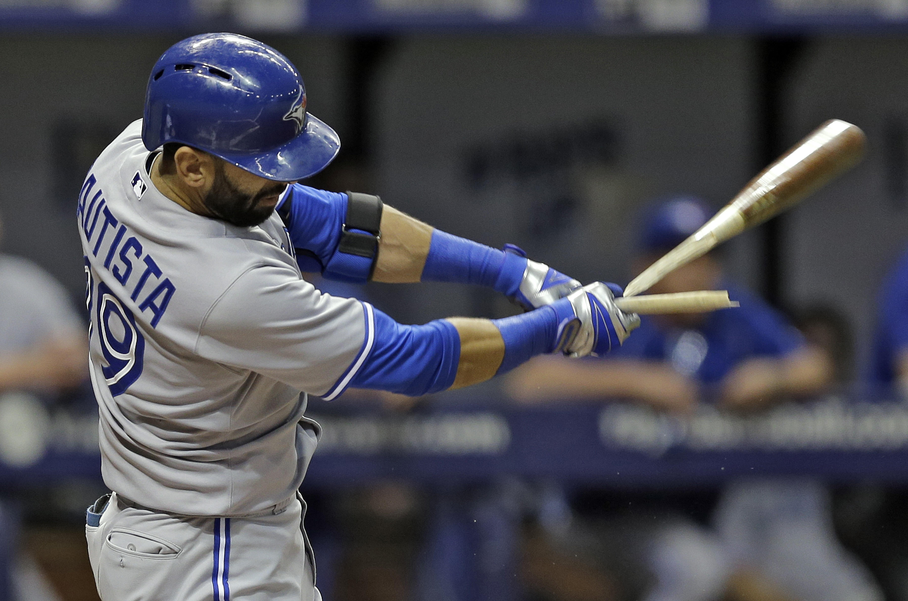 Toronto Blue Jays' Jose Bautista breaks his bat as he pops out to Tampa Bay Rays second baseman Logan Forsythe during the fourth inning of a baseball game Tuesday, June 23, 2015, in St. Petersburg, Fla.  (AP Photo/Chris O'Meara)