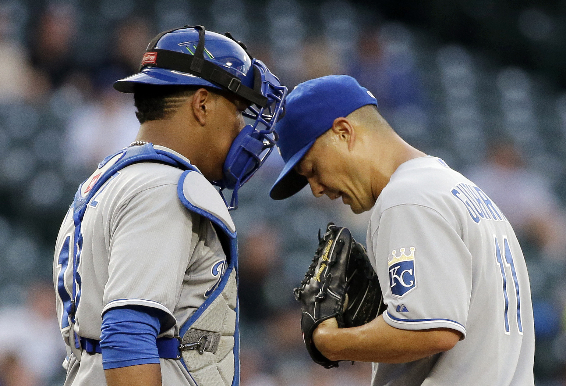 Kansas City Royals starting pitcher Jeremy Guthrie, right, and catcher Salvador Perez talk on the mound after Guthrie loaded the bases to the Seattle Mariners in the fourth inning of a baseball game Tuesday, June 23, 2015, in Seattle. (AP Photo/Elaine Tho