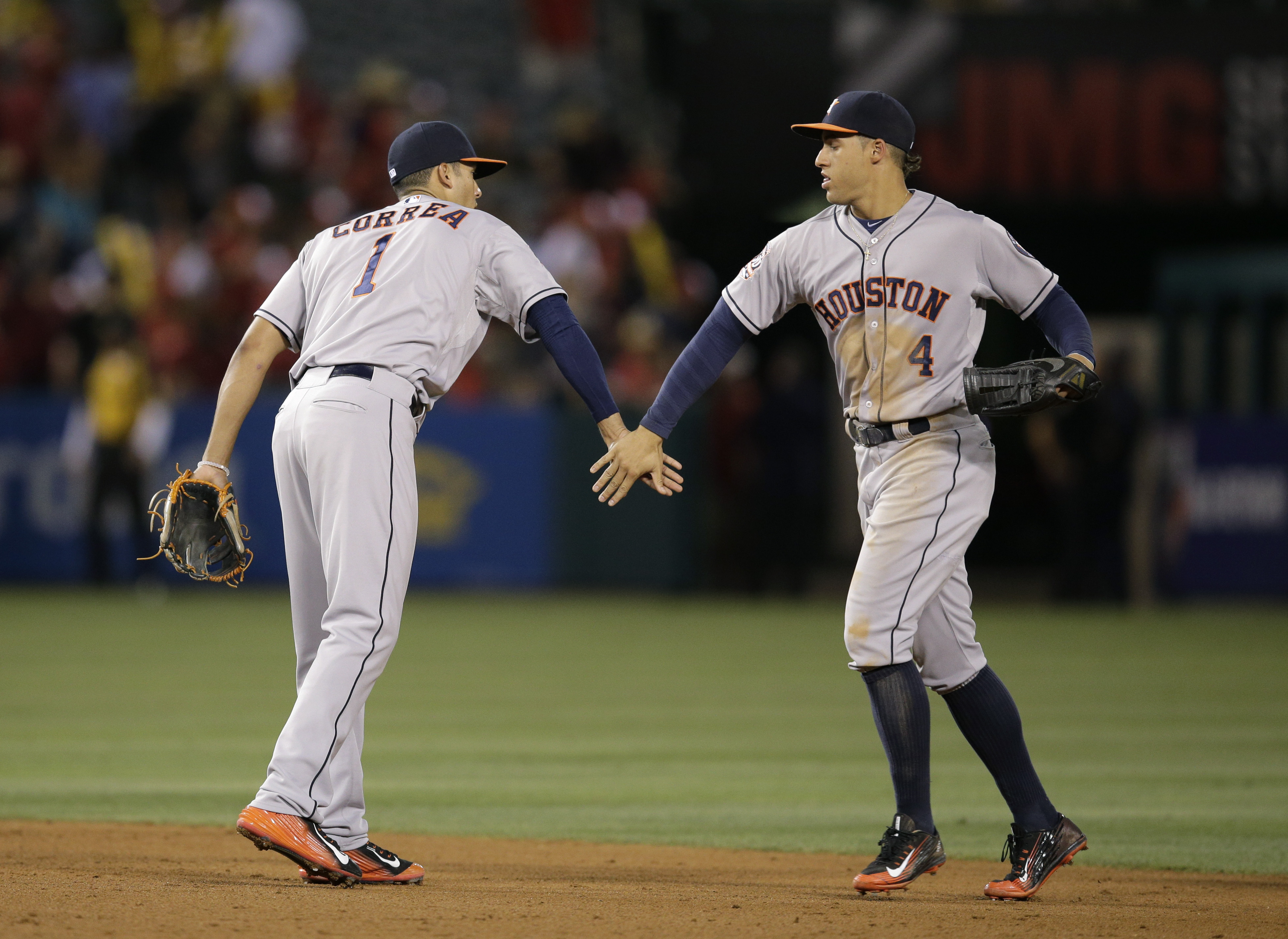 Houston Astros' Carlos Correa, left, and George Springer celebrate the team's 13-3 win against the Los Angeles Angels in a baseball game, Tuesday, June 23, 2015, in Anaheim, Calif. (AP Photo/Jae C. Hong)